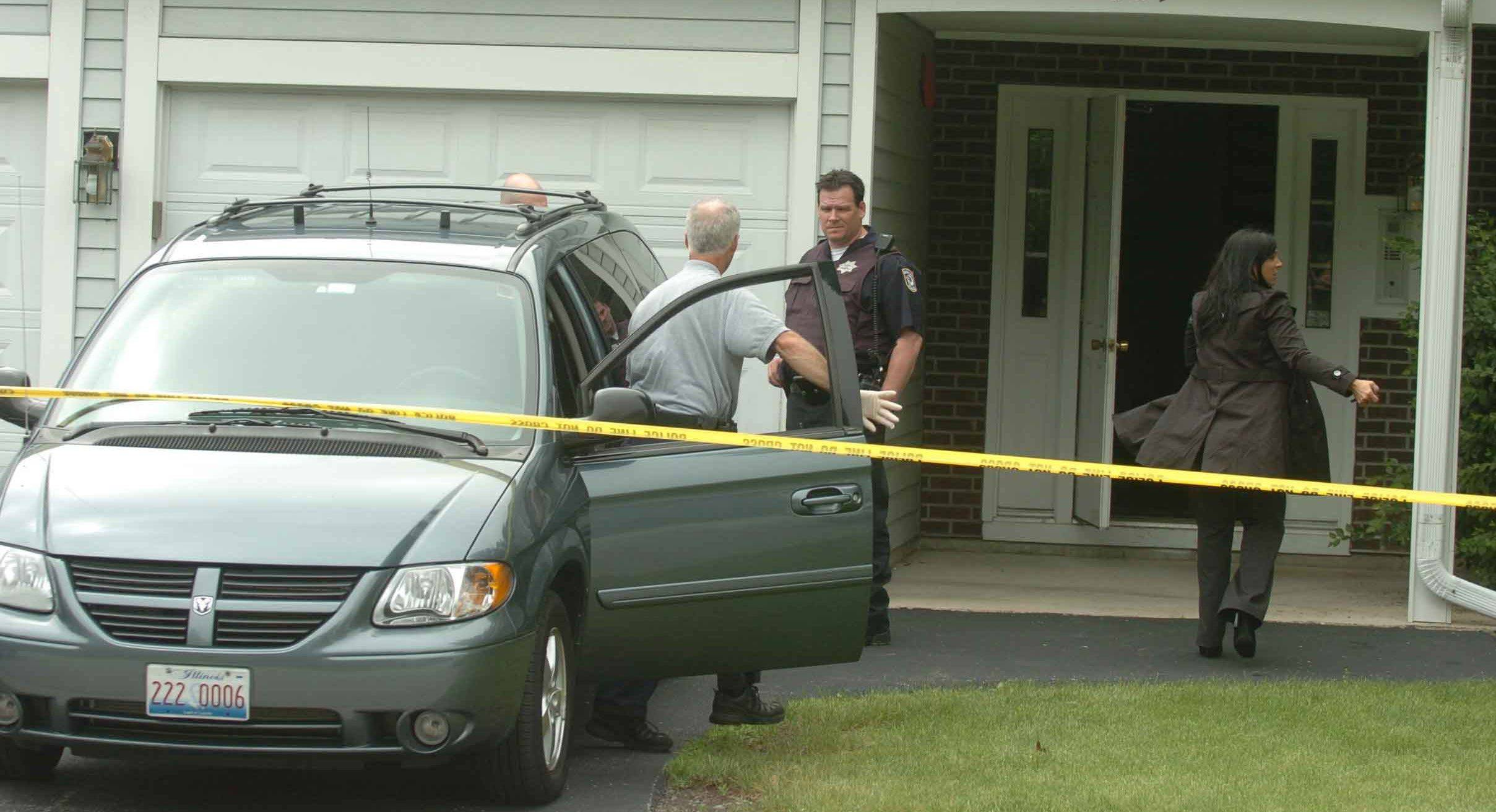 Naperville police investigate the slaying of Cathleen Lewis on Thursday.