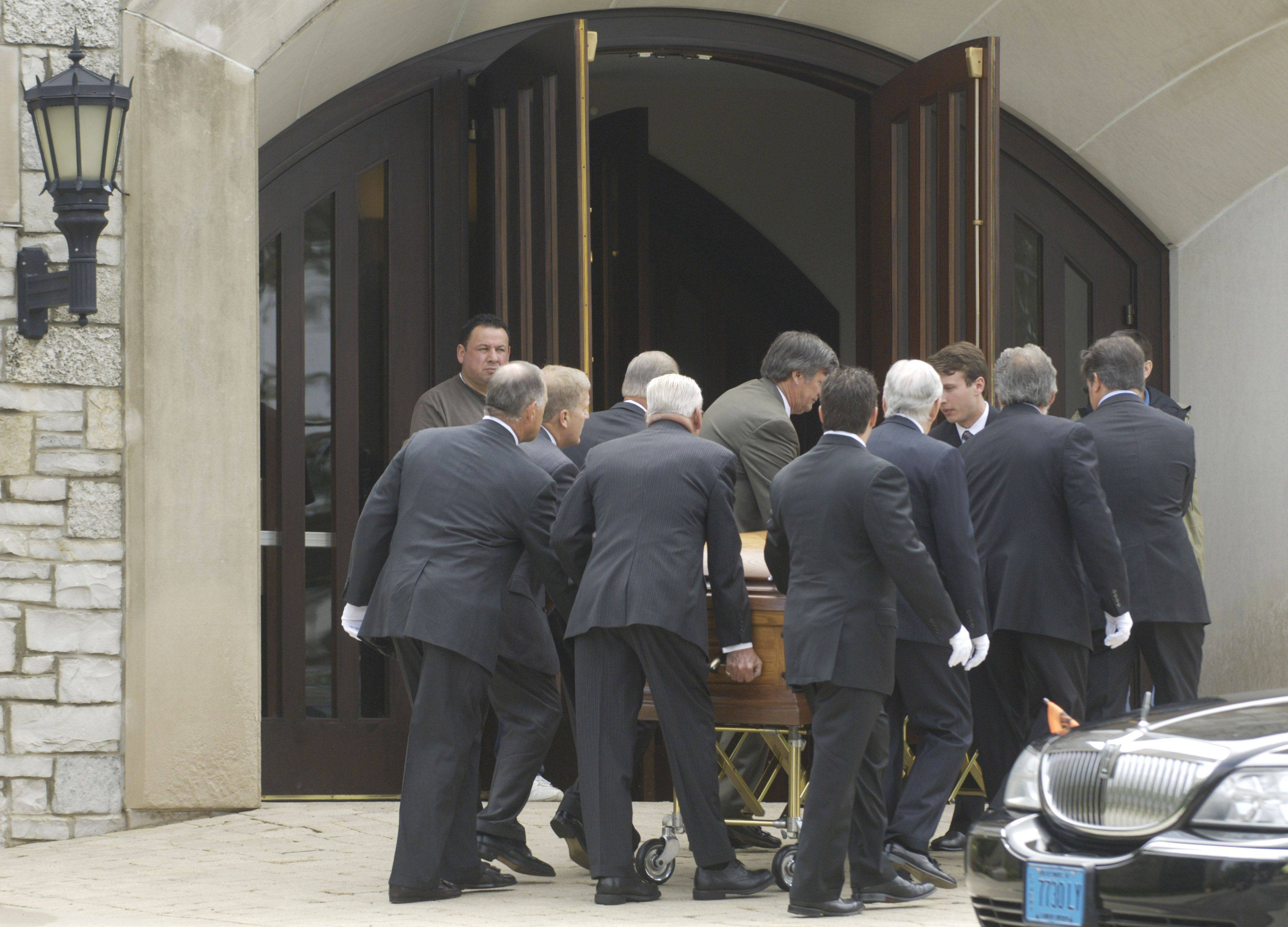 Pallbearers carry the casket from the hearse into St. Anne Catholic Church in Barrington Friday.