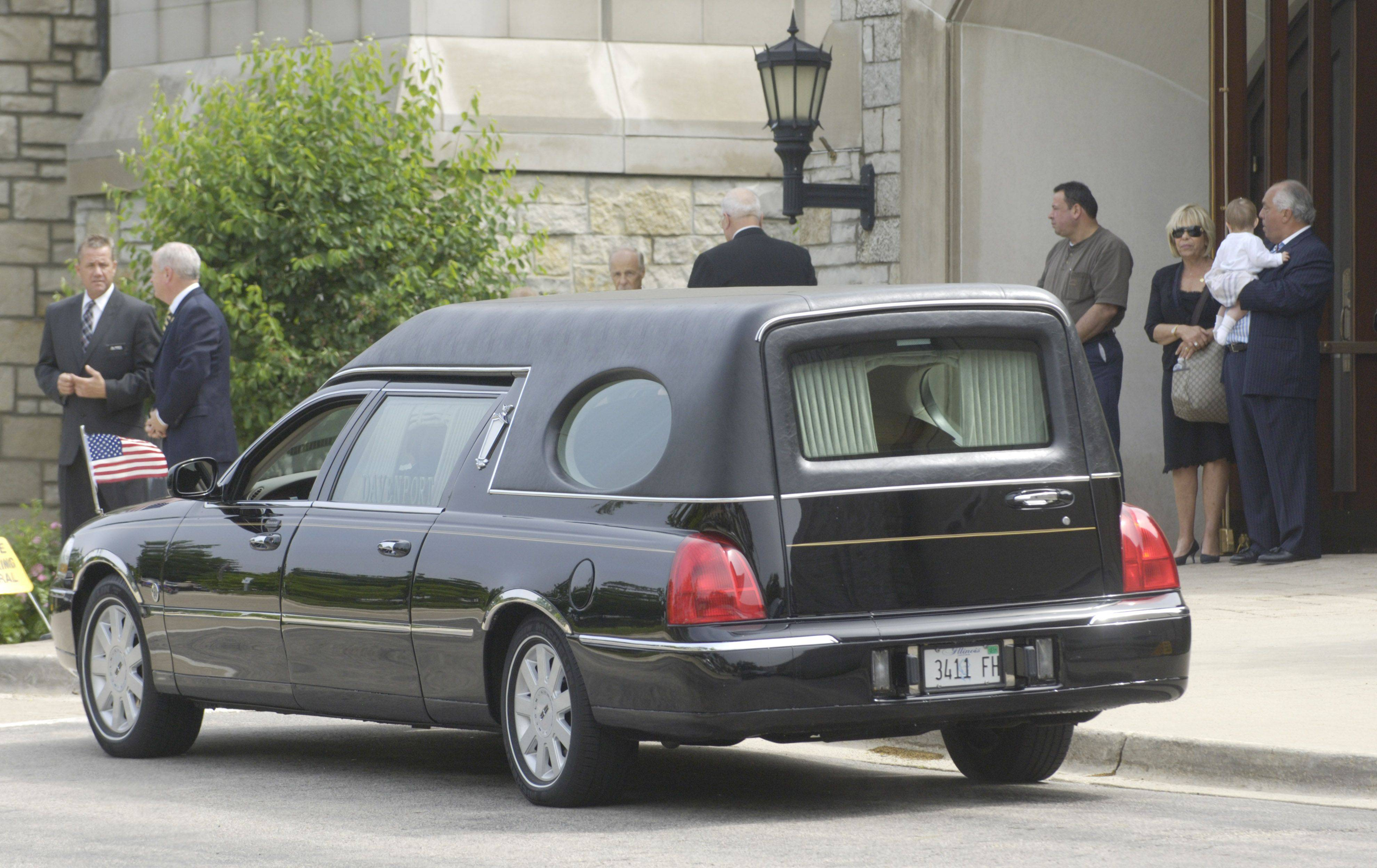 The hearse pulls up to St. Anne Catholic Church in Barrington Friday before the funeral Mass for state Rep. Mark Beaubien.