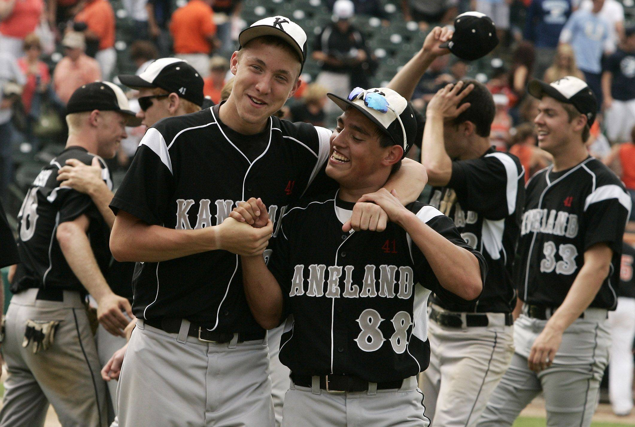 Kaneland players Trevor Heinle, left, and Jake Razo celebrate after defeating Waterloo.