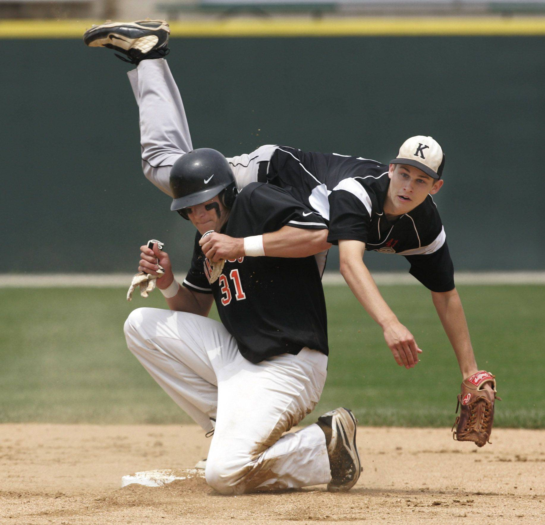 Kaneland second baseman Brian Dixon is upended by Waterloo runner Garrett Schlecht as he makes a double play in the first inning at Silver Cross Field in Joliet.