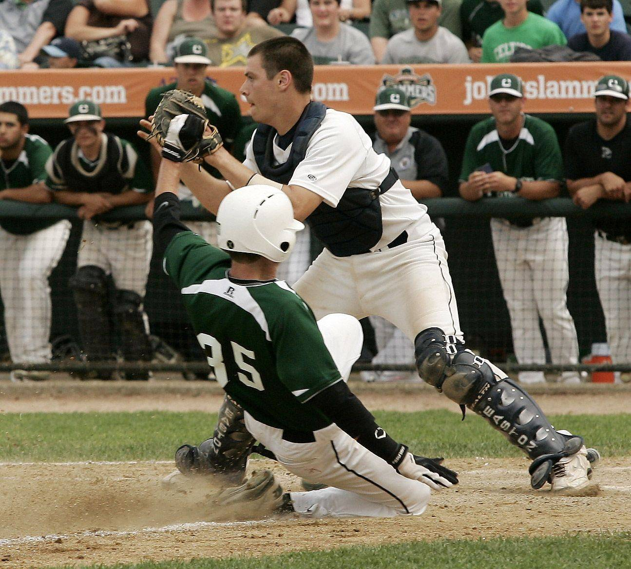 Providence runner Brady Wilkin slides safely under the tag of Prospect catcher Kurt Donner in the third inning at Silver Cross Field in Joliet.