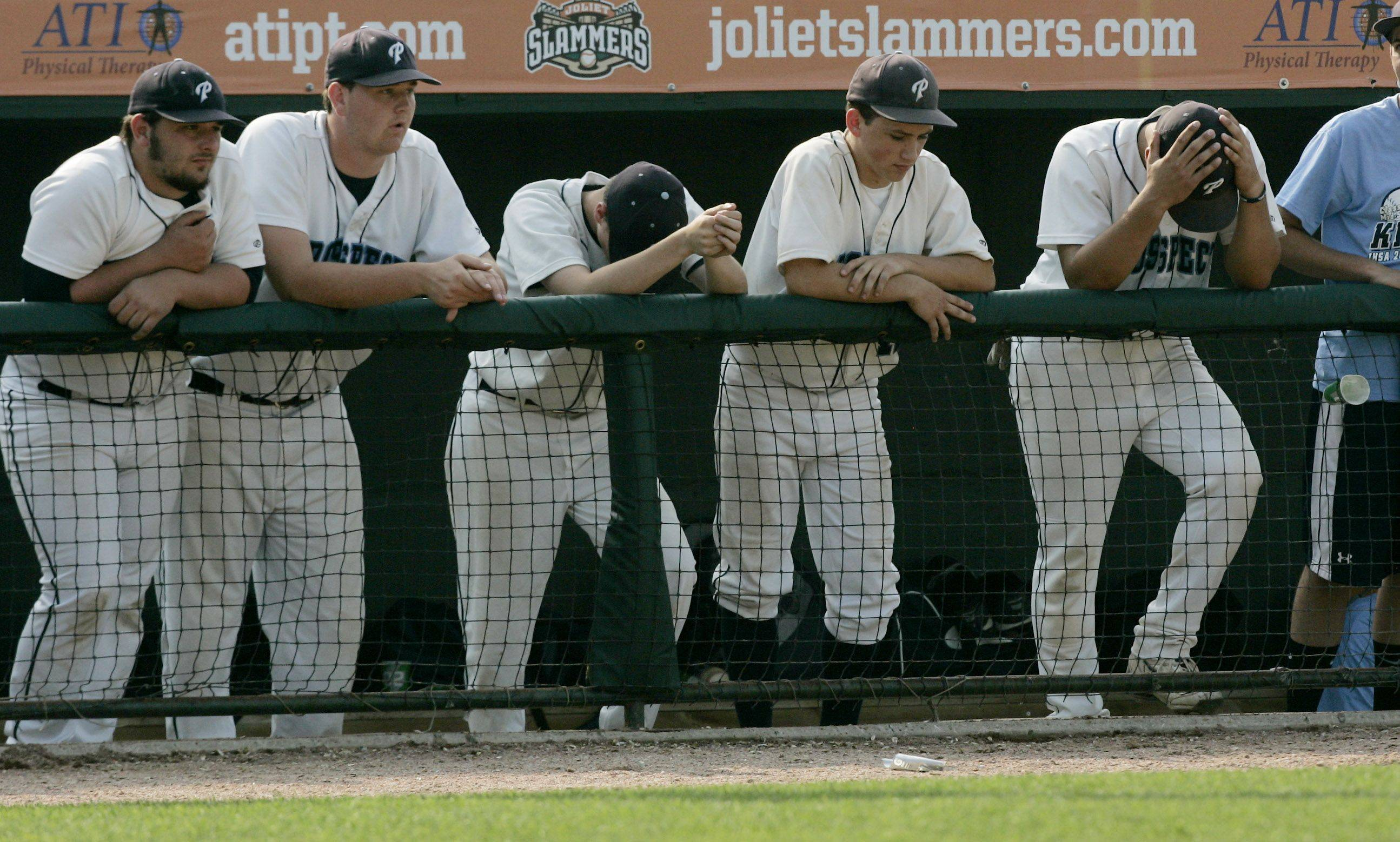 Prospect players react in the dugout after a 9-1 loss to Providence Catholic.