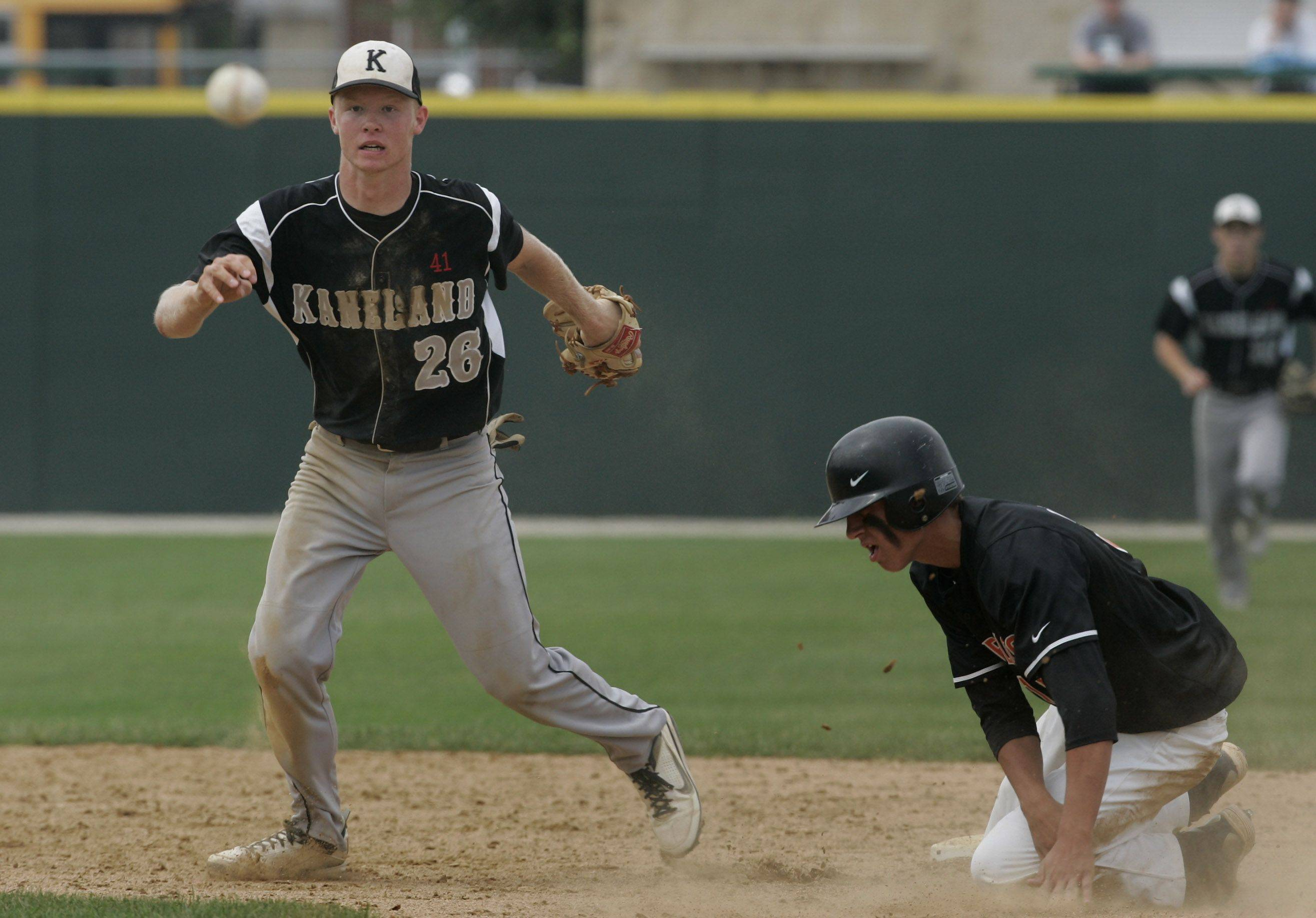 Kaneland's Kyle Davidson makes a double play as he gets the out at second base against Waterloo runner Eli Snodgrass.