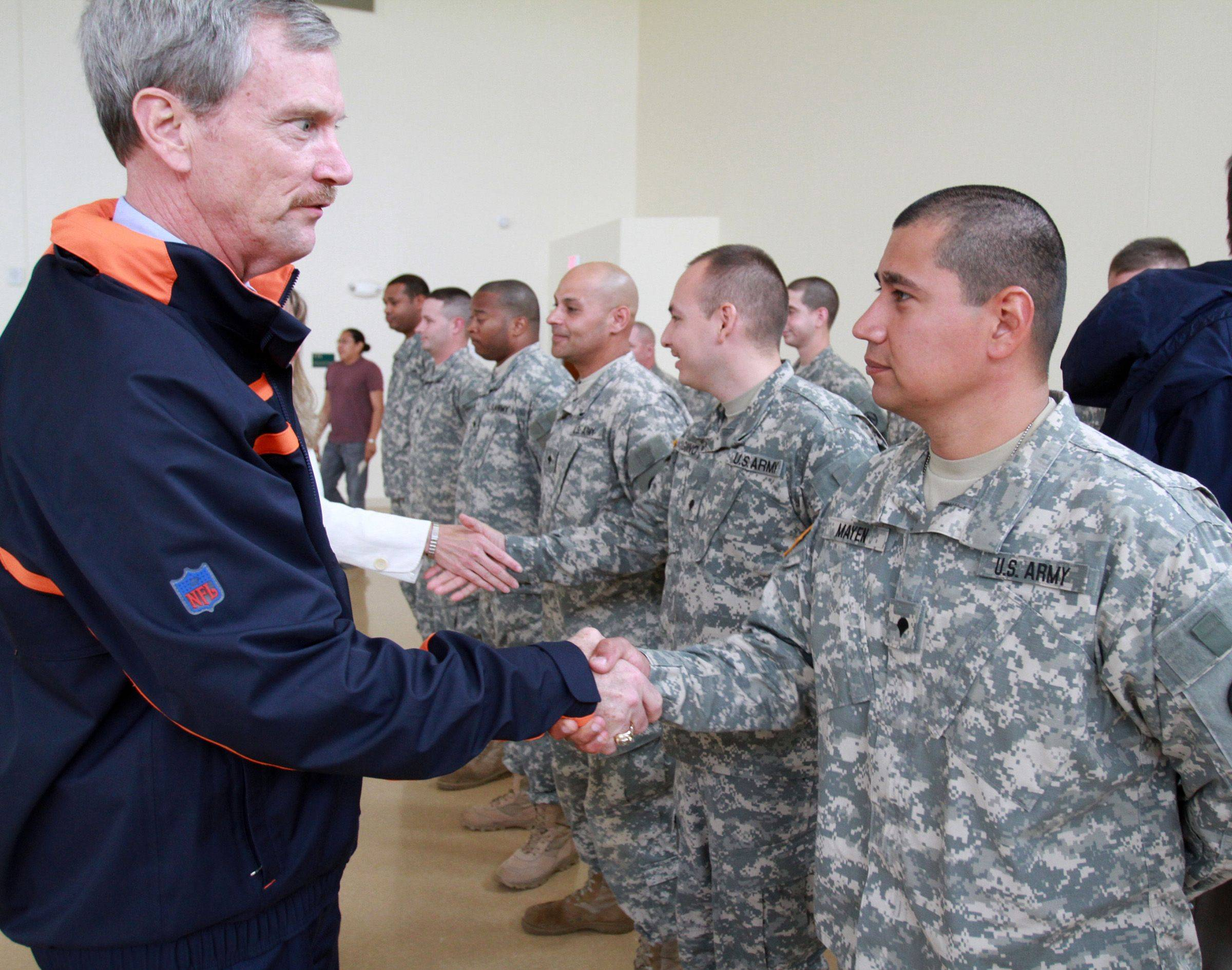 George McCaskey, chairman of the Chicago Bears, greets SPC Cesar Mayer of Elgin, a member of the Army Reserve 226th Port Management Team. McCaskey attended a farewell ceremony at Fort Sheridan on Thursday for the unit, which will spend the next year serving in Kuwait.