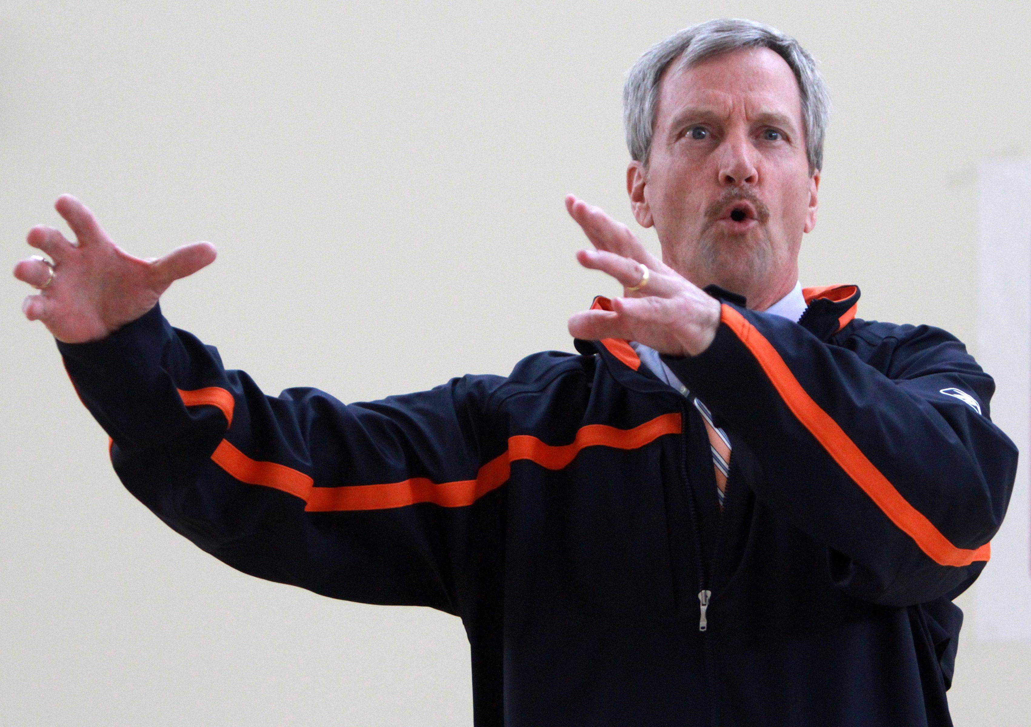 George McCaskey, chairman of the Chicago Bears, explains how the Bears honor veterans before each home game while speaking to members of the U.S. Reserve 226th Port Management Team at Fort Sheridan on Thursday.