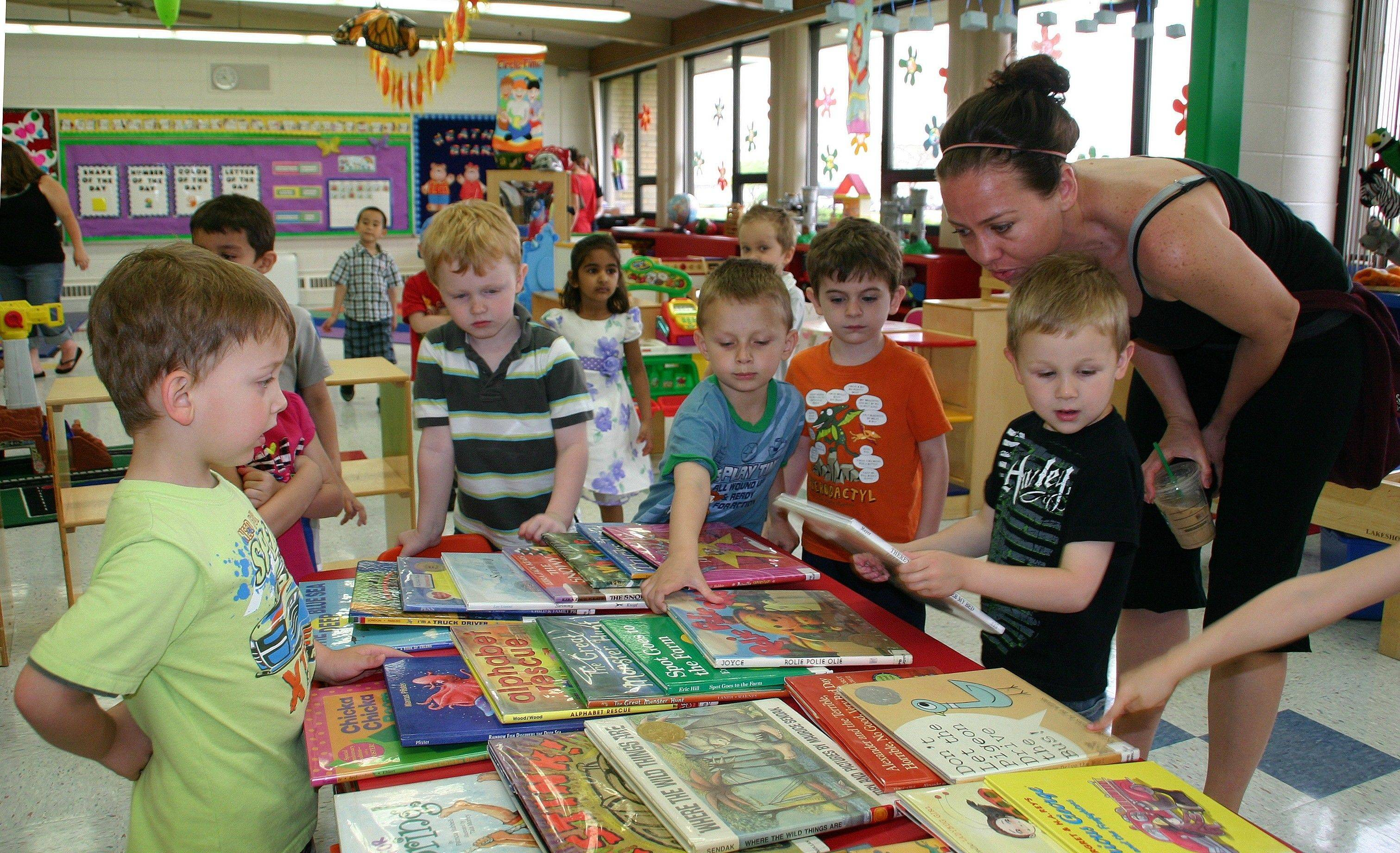 Children and their guests chose from over 100 books at the fifth annual Brunch with Books on May 11 and 12 in the Terrific 3's Creative Corners preschool class.