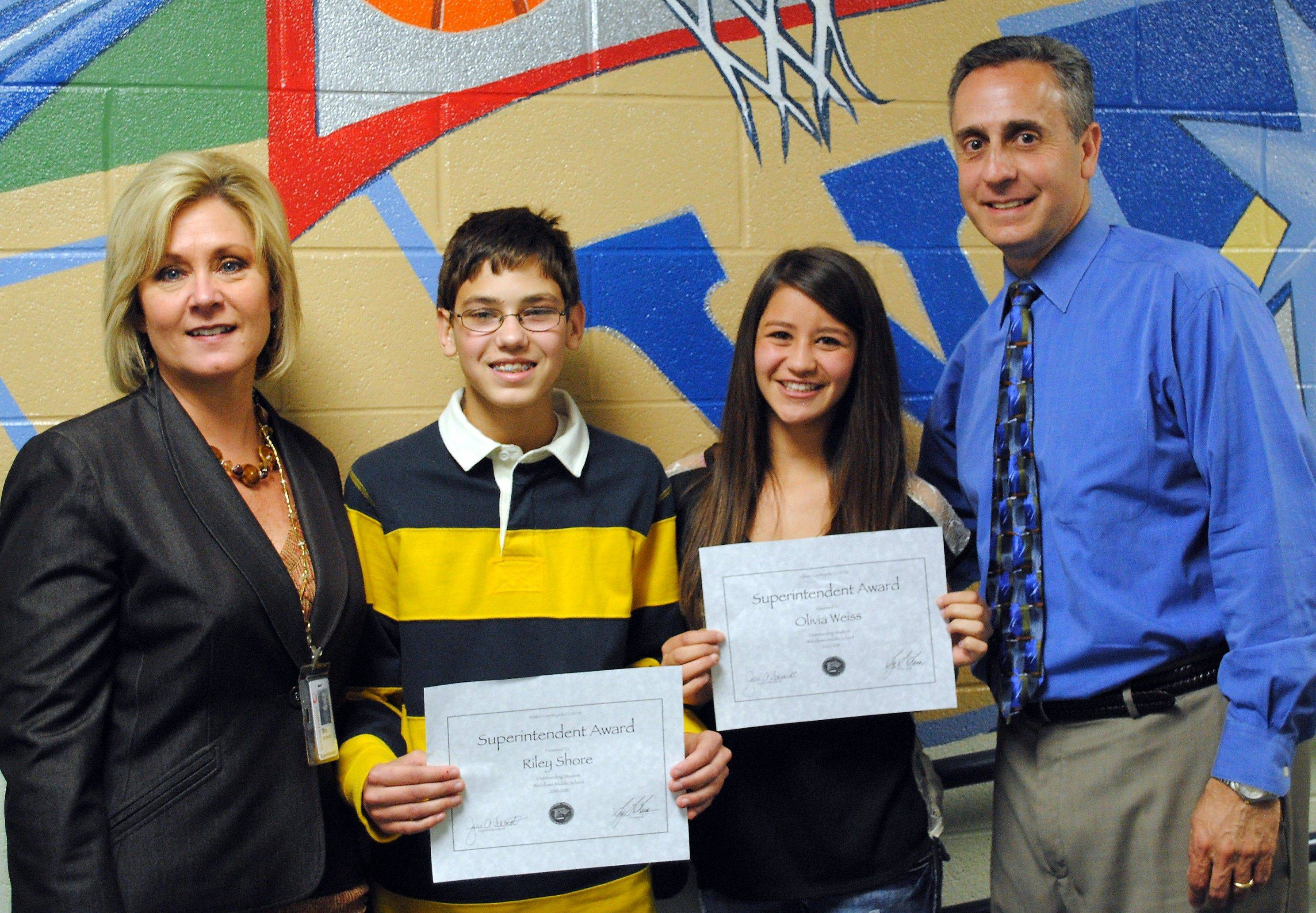With District 96 Superintendent Julie Schmidt, from left, are Superintendent Award recipients, eighth-graders Riley Shore and Olivia Weiss and Woodlawn Middle School Principal Greg Grana.