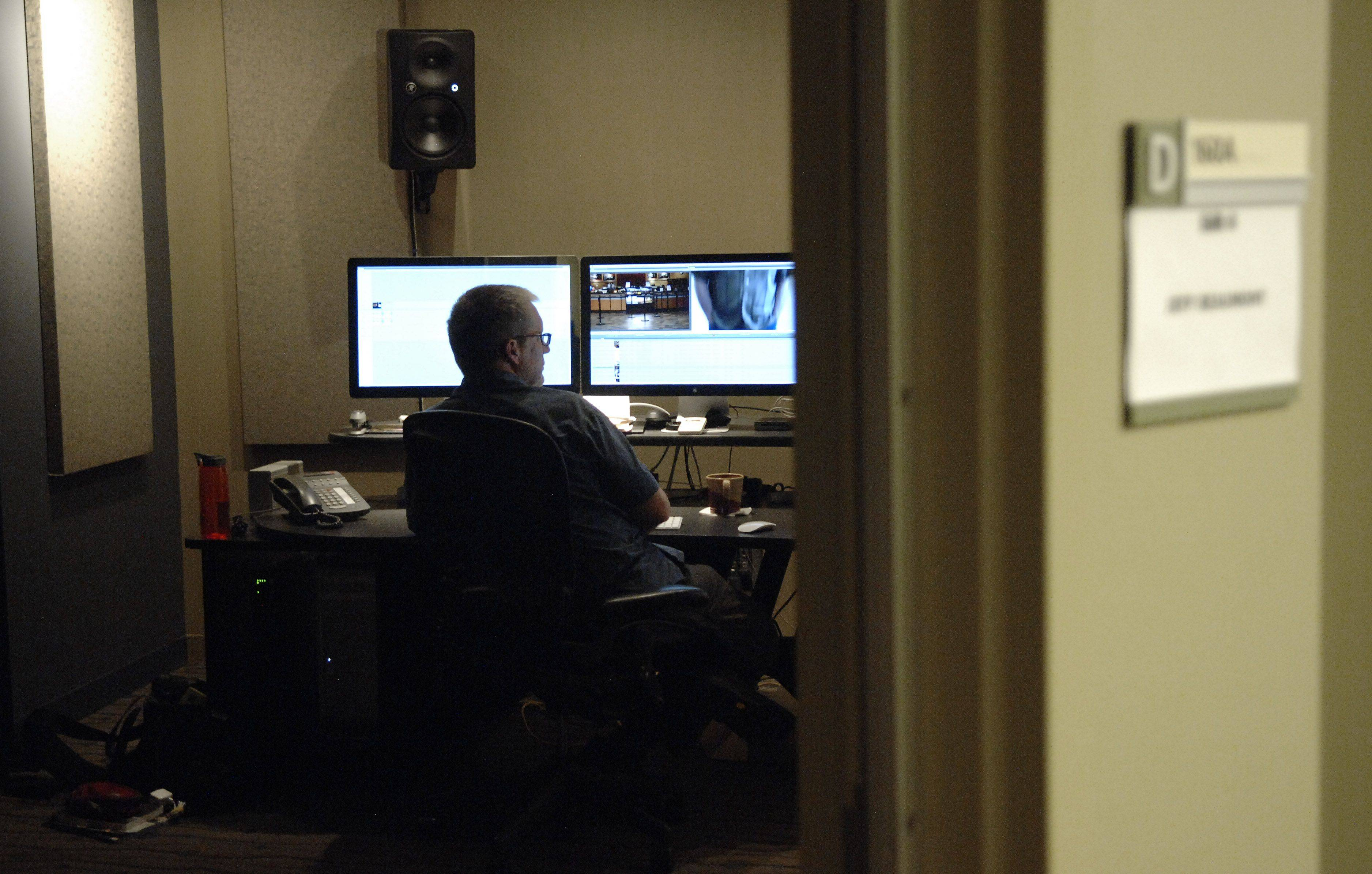 Video producer/editor Jeff Beaumont works in one of the post production video suites.