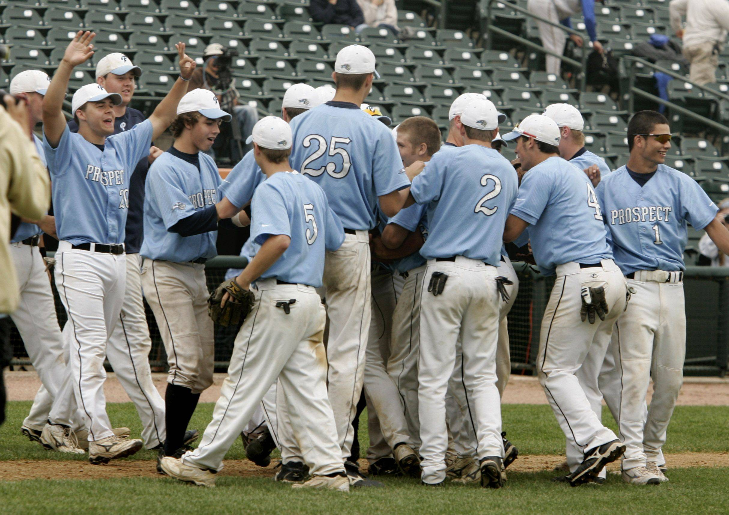 The Prospect baseball team celebrates after defeating Mt. Carmel during the boys high school baseball game Saturday in the Class 4A 3rd place game at Silver Cross Field in Joliet. Prospect defeated Mt. Carmel 2-1 to win third place in the state.