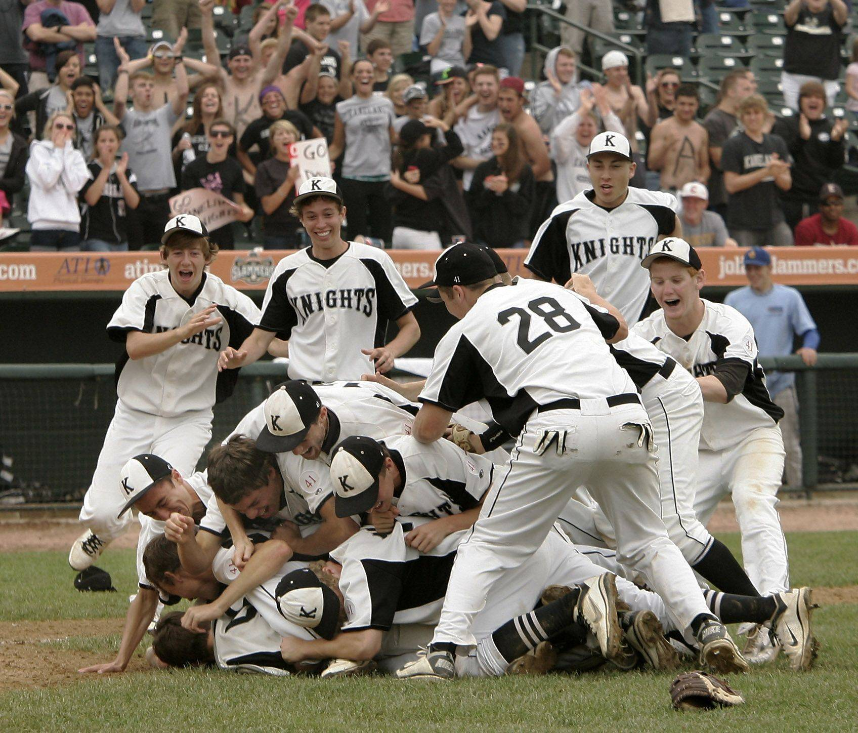 Kaneland players rush to the field after defeating Oak Forest for the state championship during the boys high school baseball game Saturday in the Class 3A state finals at Silver Cross Field in Joliet. Kaneland defeated Oak Forest 11-3.