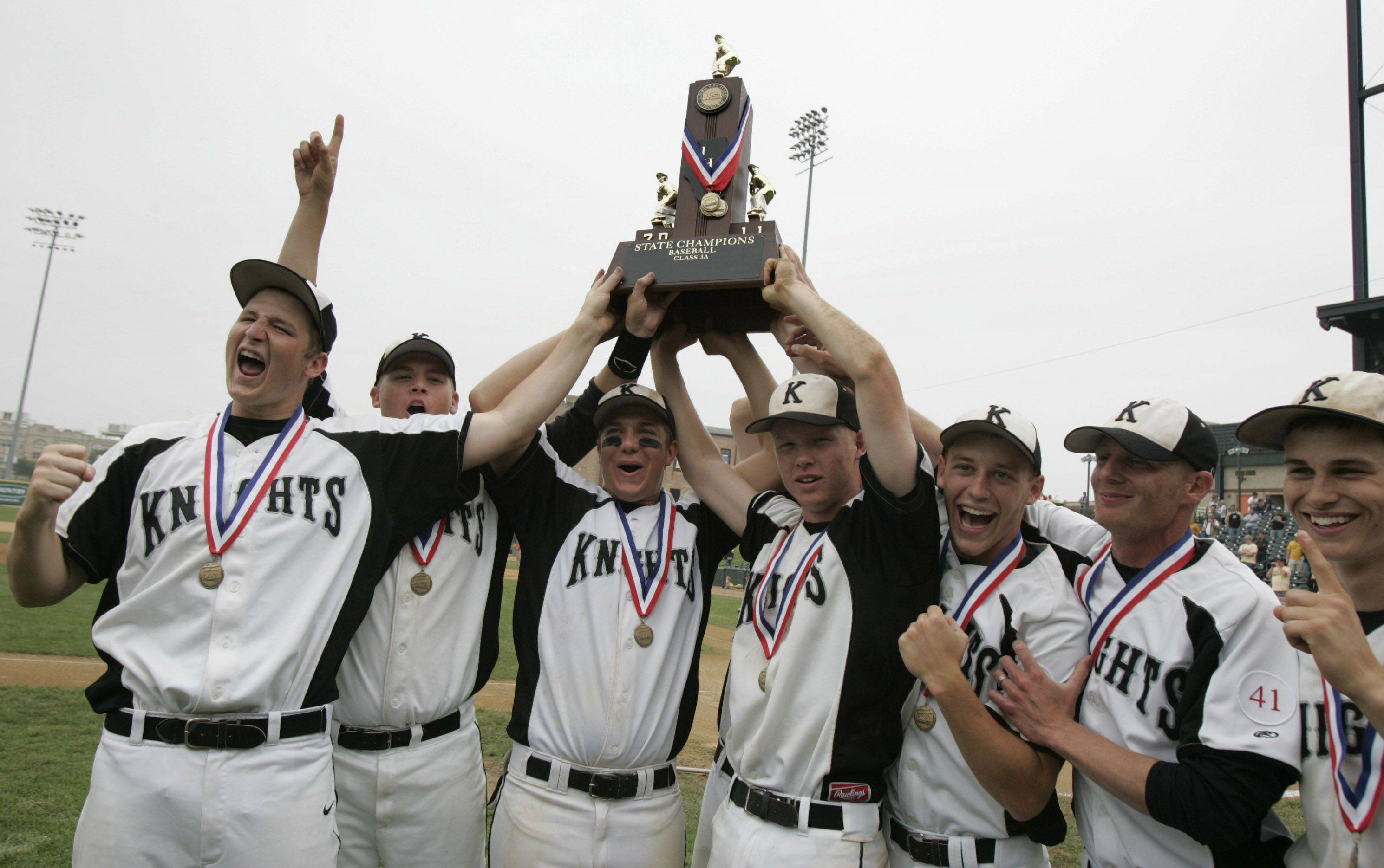 Kaneland baseball players hold up the state trophy after defeating Oak Forest during the boys high school baseball game Saturday in the Class 3A state finals at Silver Cross Field in Joliet. Kaneland defeated Oak Forest 11-3 to win the state championship.