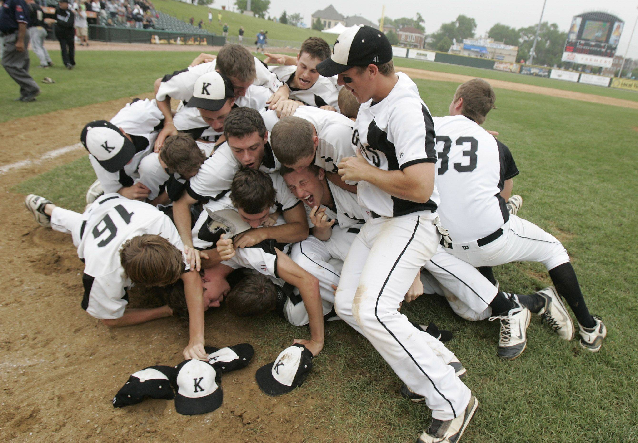 Kaneland players make a dogpile after defeating Oak Forest in the boys high school baseball game Saturday in the Class 3A state finals at Silver Cross Field in Joliet. Kaneland defeated Oak Forest 11-3 to win the state championship.