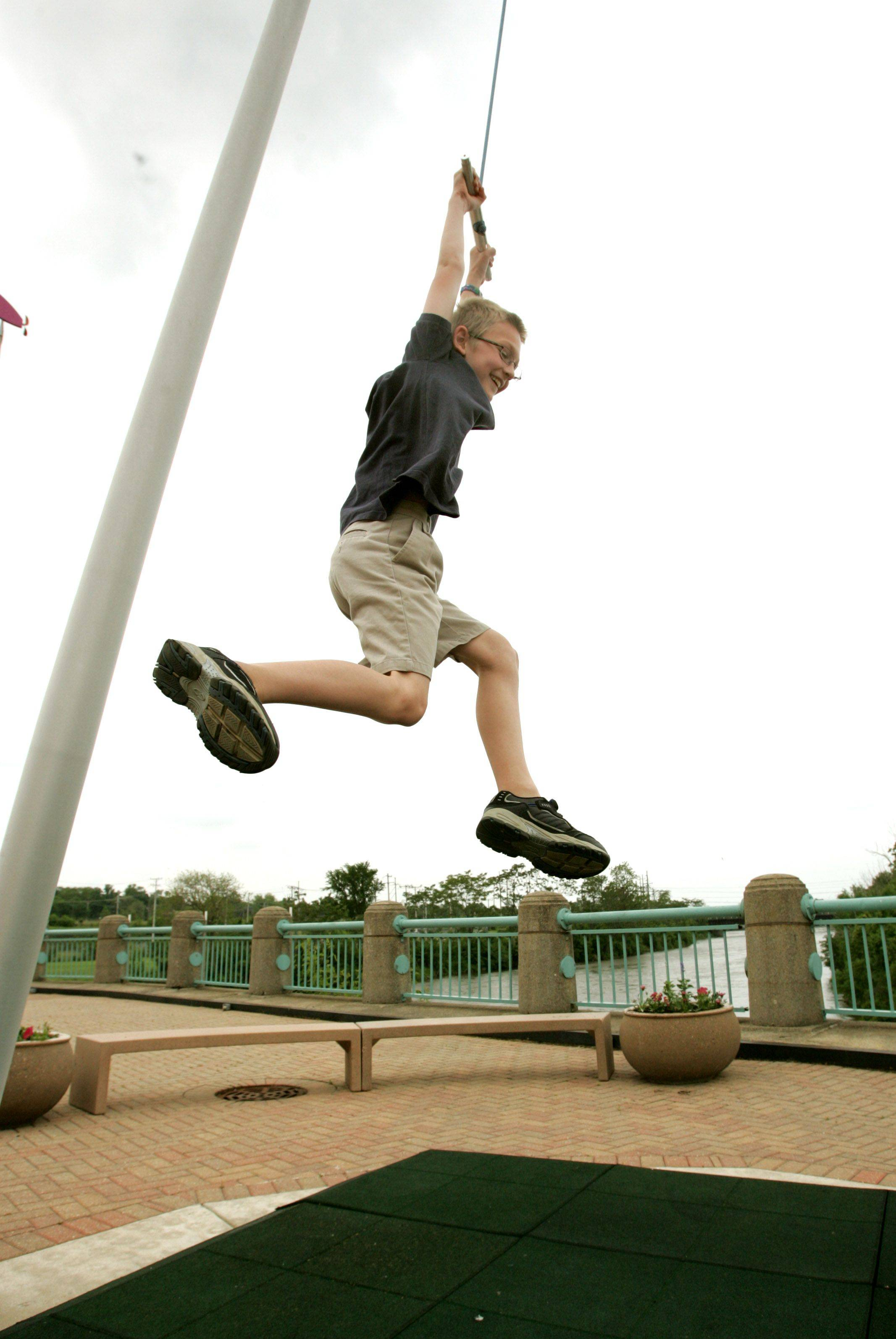 "Marshall Schiele, 9, of Bartlett, swings on the ""you-yo"" in the outdoor park at SciTech Hands-on Museum in Aurora. The you-yo and the outdoor park will be open again this summer after years of standing idle."
