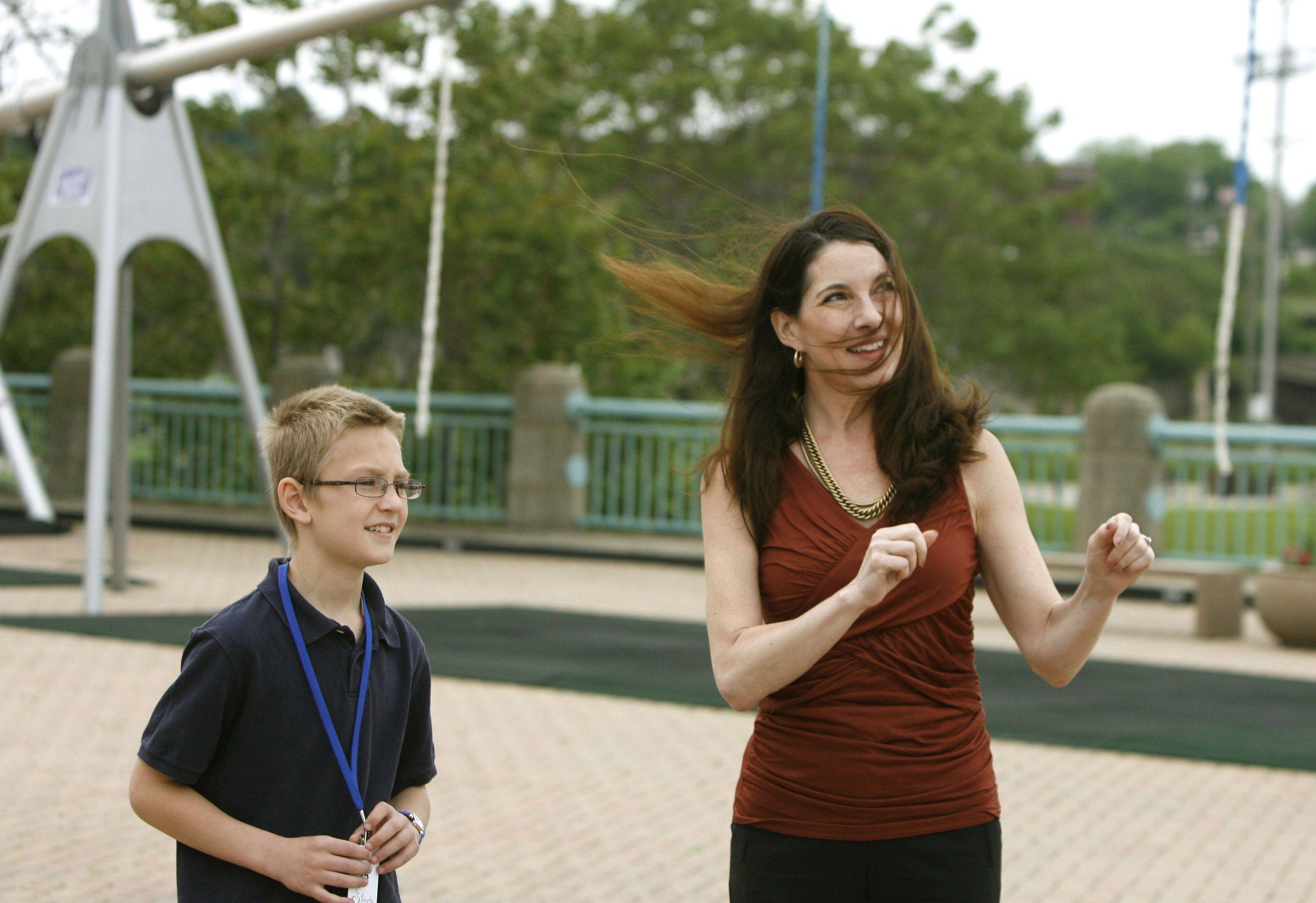 Carol Rehtmeyer, executive director of SciTech Hands-on Museum in Aurora, shows the museum's outdoor park to Marshall Schiele, 9, of Bartlett, who was there on a field trip.