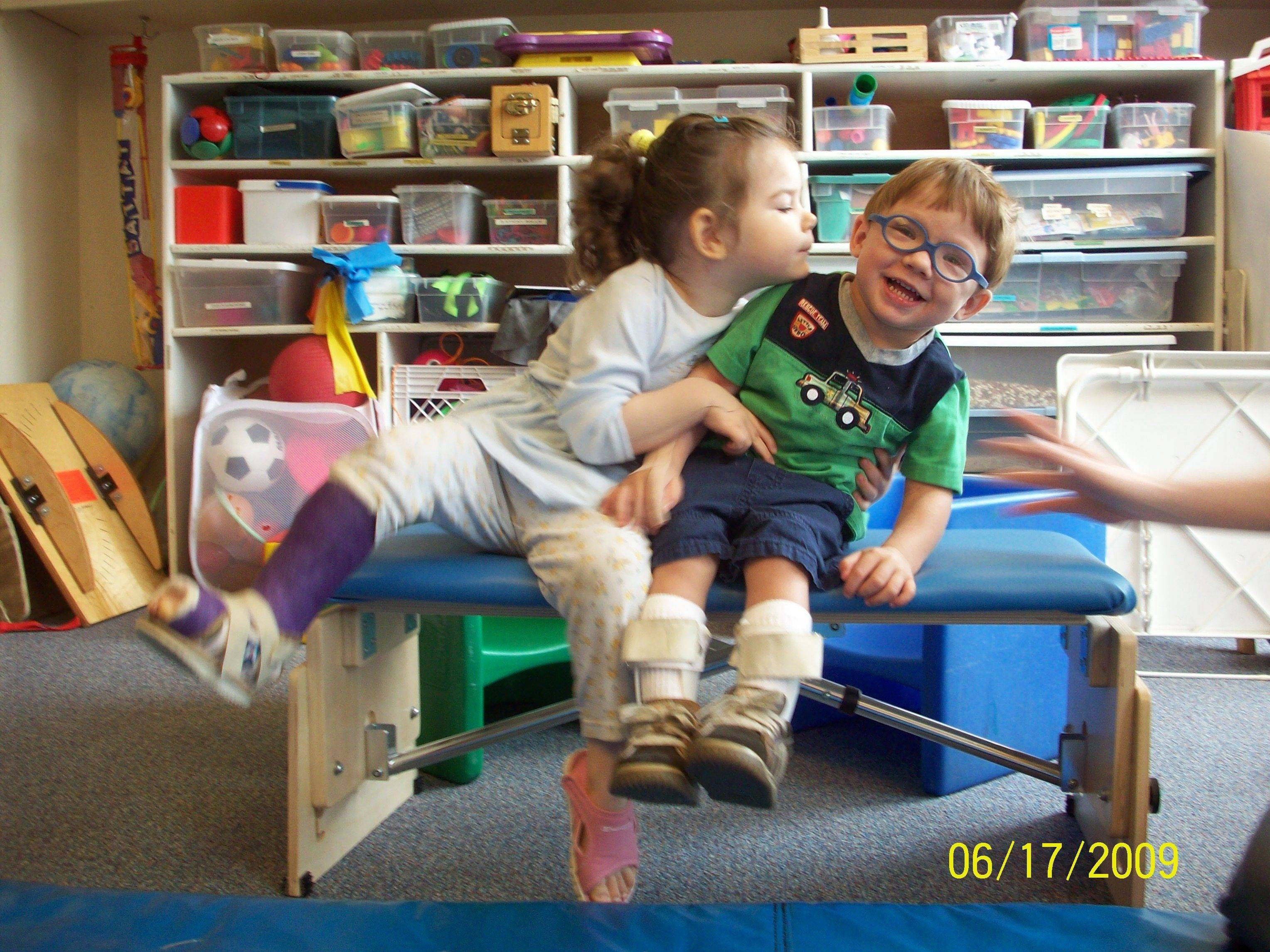 Ivy Joy Knight, left, and Charlie Krupka pal around during a therapy session at Easter Seals.