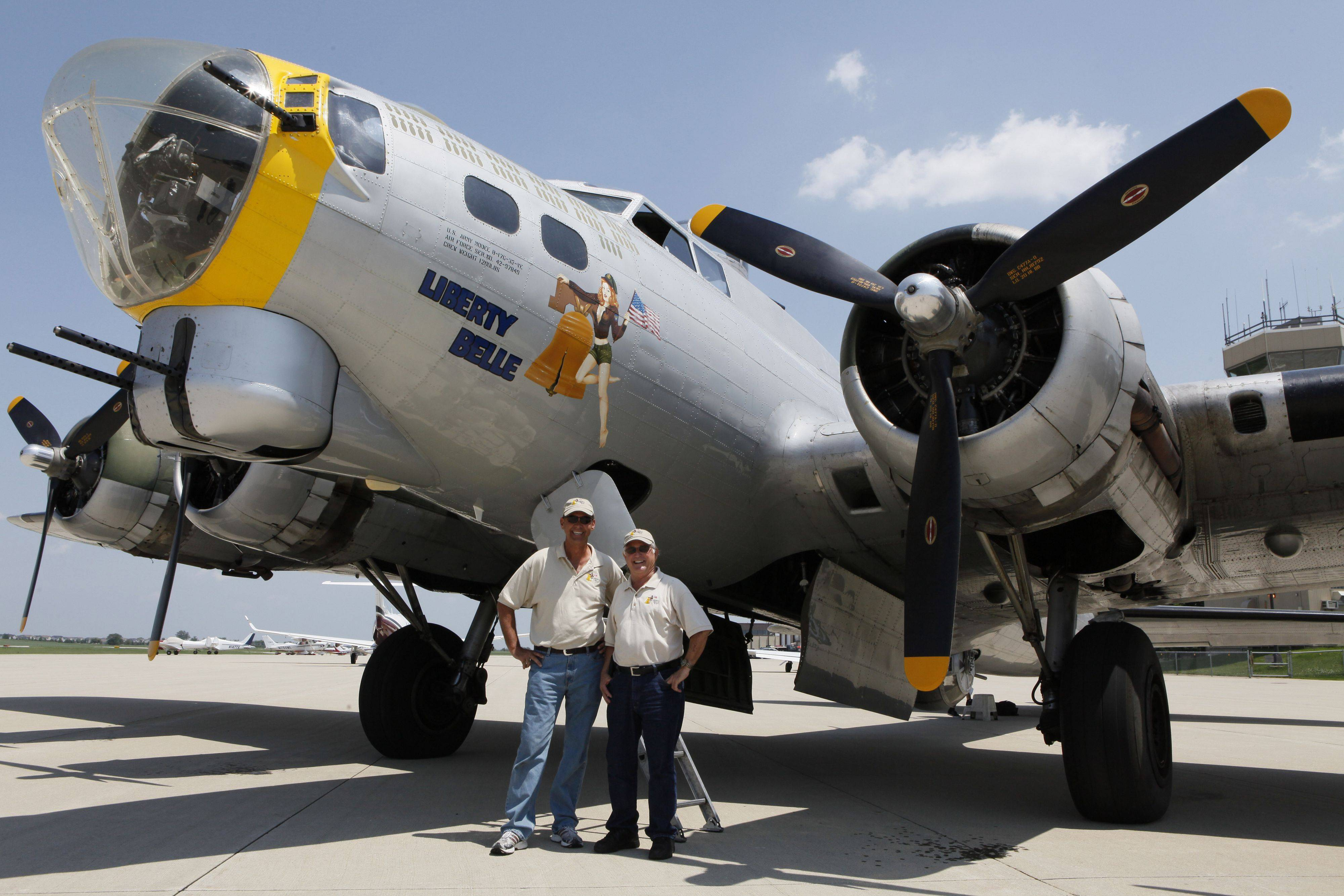 Pilot Mike Walton and co-pilot Dave Lyon stand next to their B-17 Flying Fortress bomber that they flew into Aurora Municipal Airport in Sugar Grove last week. The bomber is part of the Liberty Foundation.