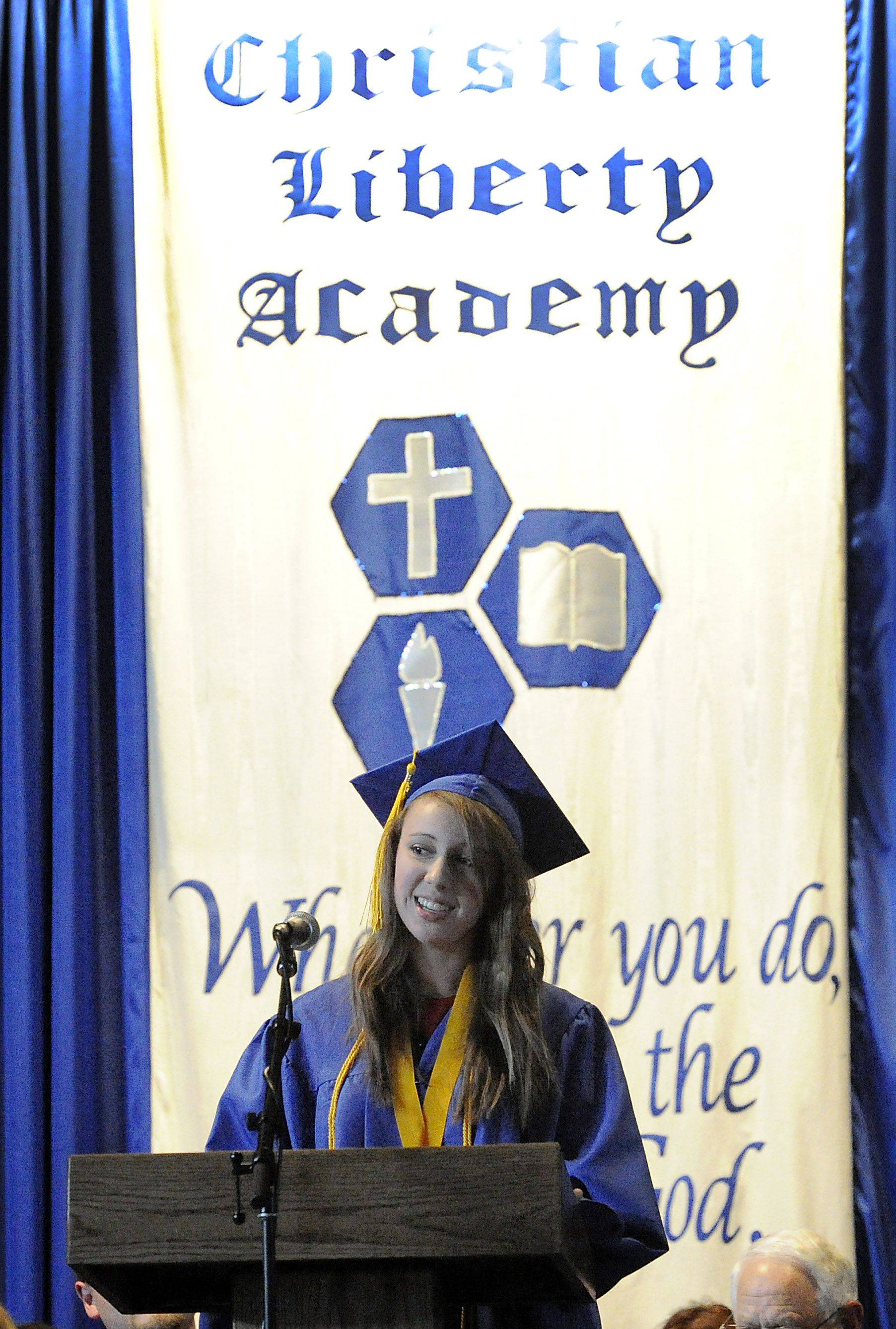 Lilli Stushek gives the salutatory address to 38 of her fellow classmates at the Christian Liberty graduation in Arlington Heights on Sunday.