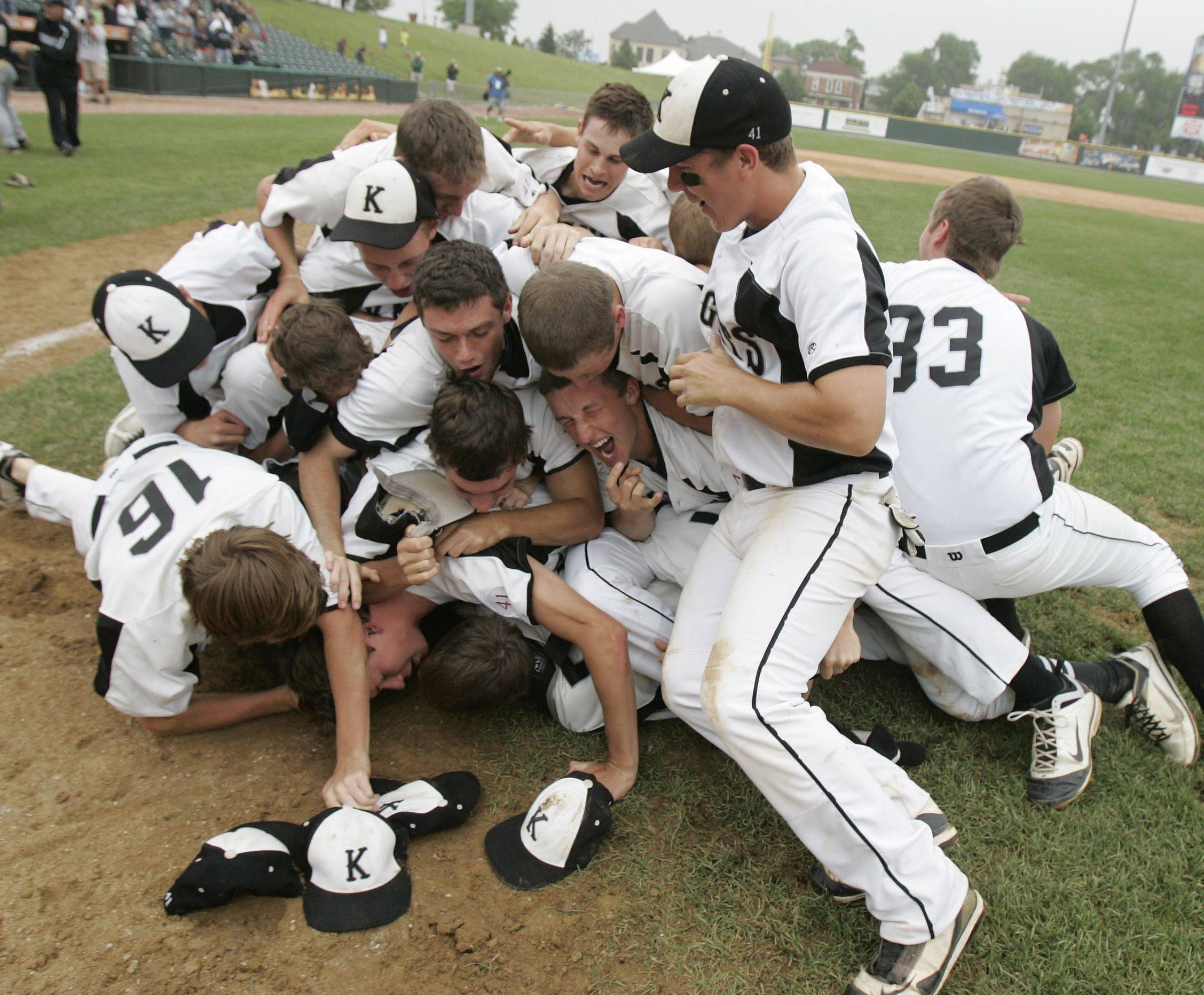 Kaneland players pile on each other after defeating Oak Forest 11-3 in the Class 3A state championship game at Silver Cross Field in Joliet on Saturday.