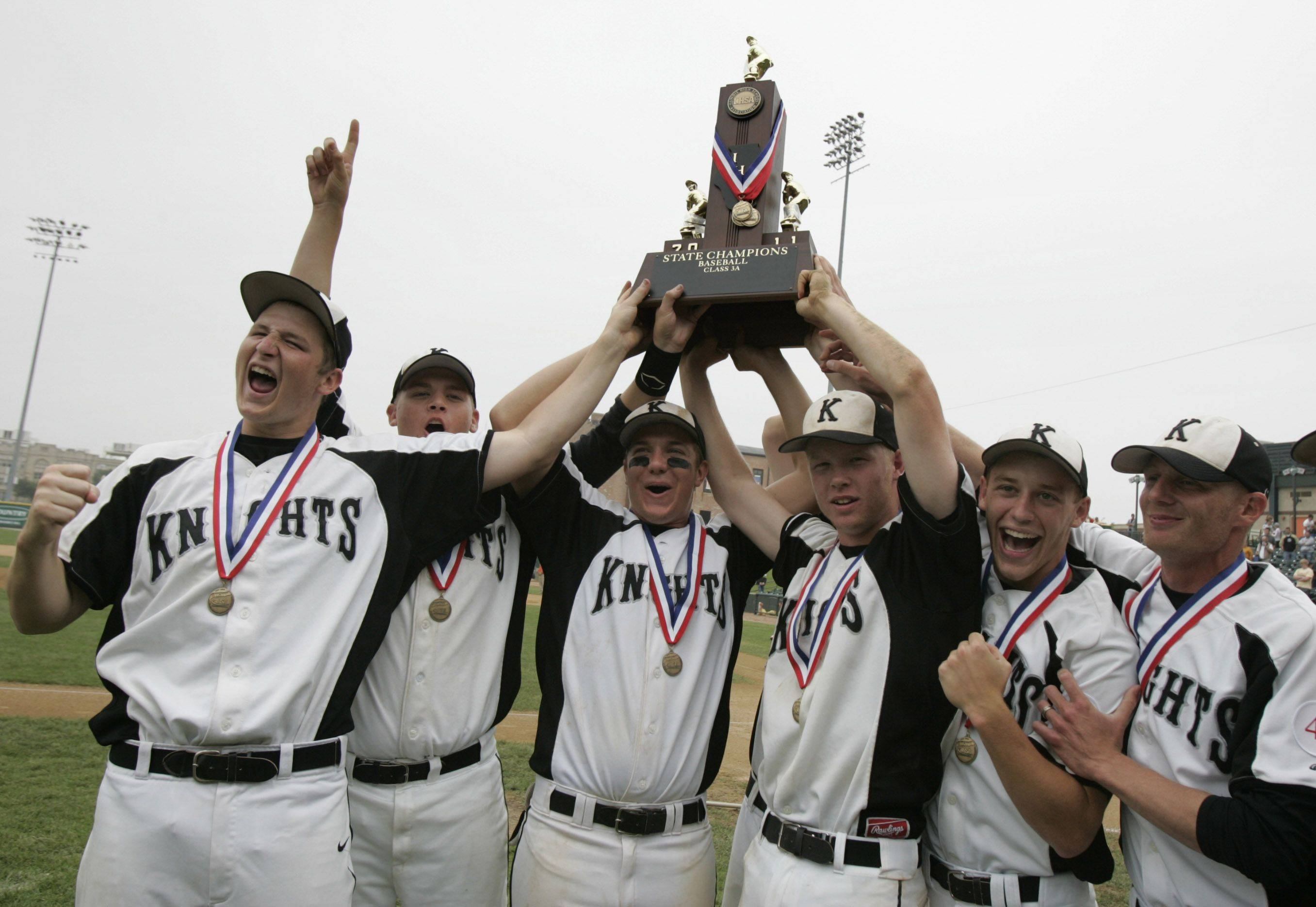 Kaneland shows off its Class 3A state championship trophy.