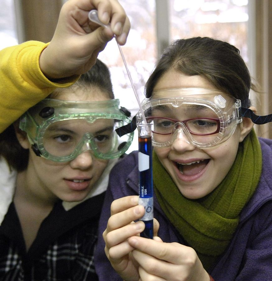 Elena Silva, left, and Olivia Halik, conduct an experiment in their seventh grade science class at Fox River Country Day School in Elgin.