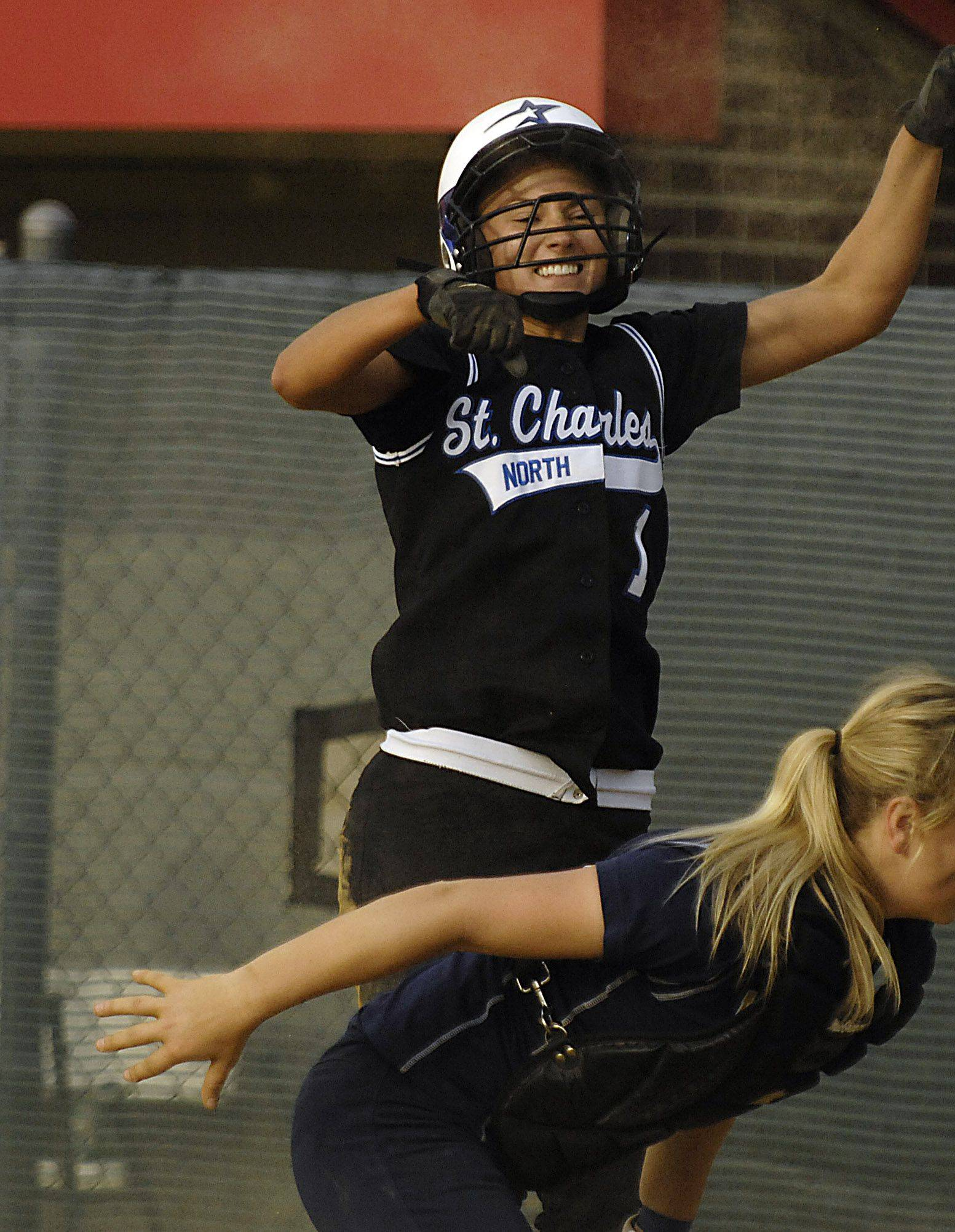 St. Charles North's Loren Cihlar jumps up after scoring the winning run in the bottom of the 10th inning against Leyden in the sectional semifinal game Thursday in Schaumburg.