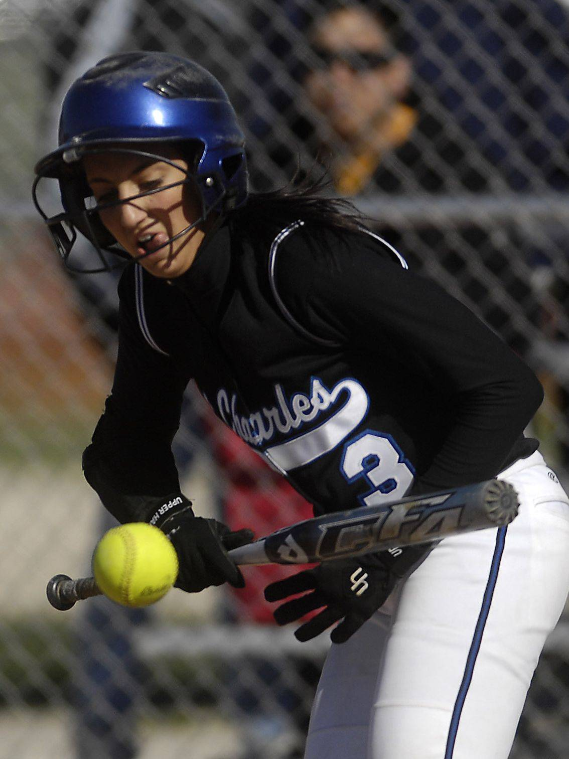St. Charles North's Natalie Capone gets a bunt down against St. Charles East during Tuesday's game at East.