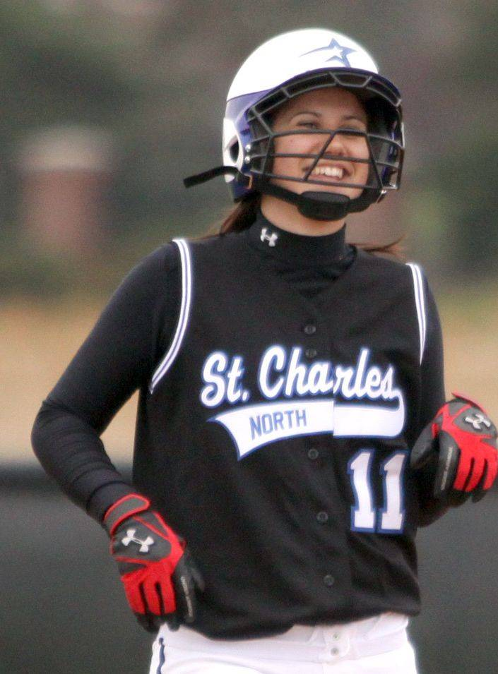 St. Charles North's Caitlin Khoury is all smiles after arriving at second base on a stand-up double during a varsity softball game at St. Charles East on Monday afternoon.