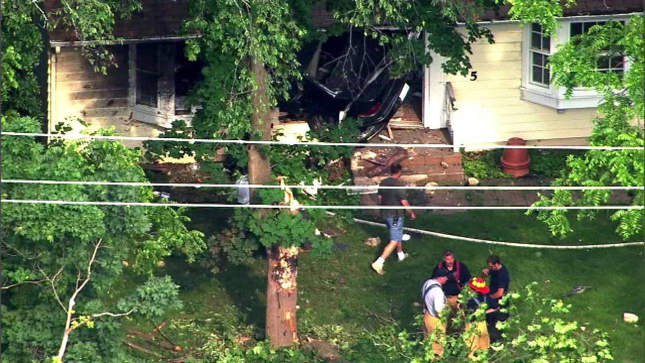 This aerial view reveals where a car struck a home along Route 31 at Mooseheart Road on Tuesday afternoon.