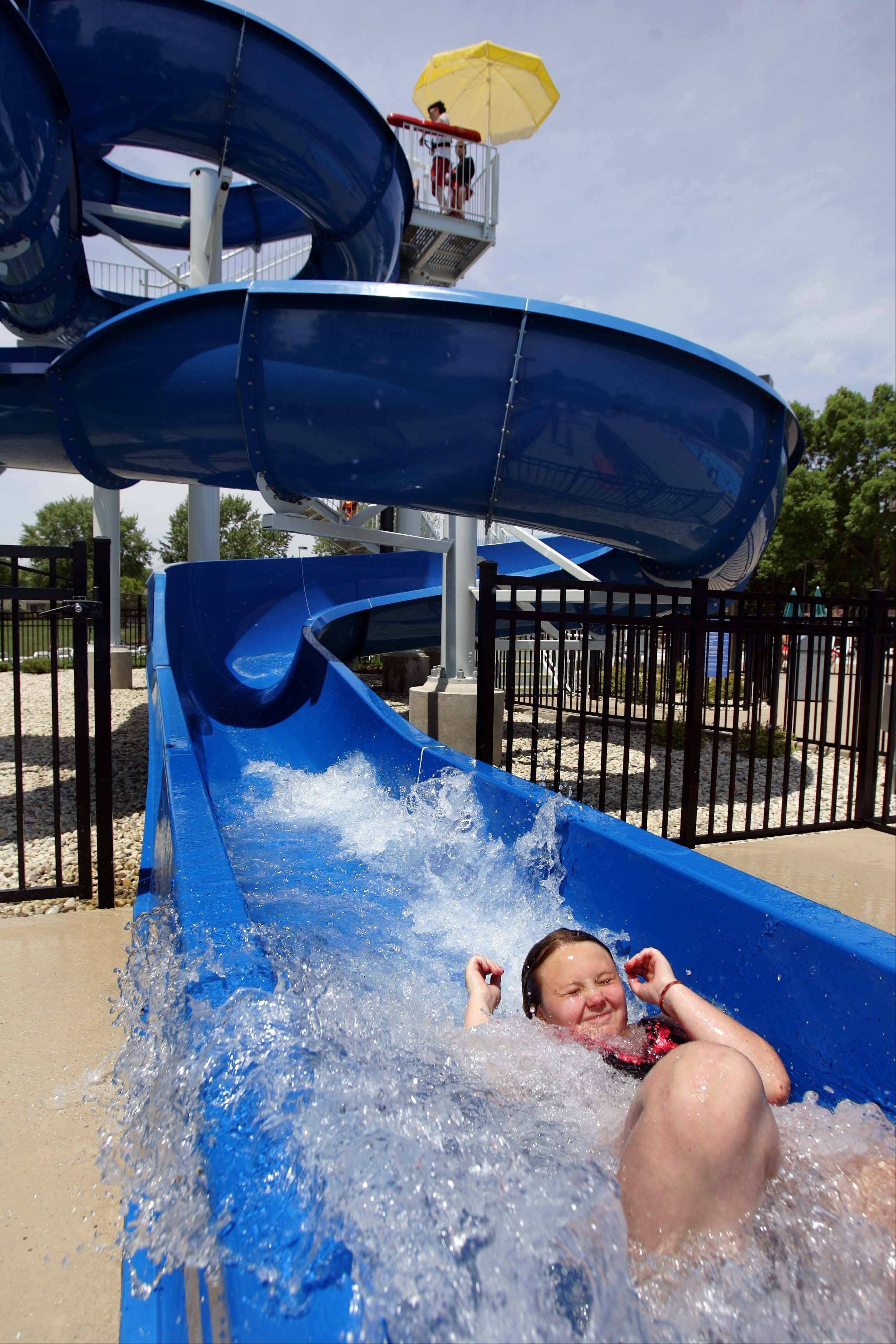 Ten-year-old Hannah Potocki rockets down the new slide at Willow Stream Pool in Buffalo Grove which will have it's grand opening this weekend. Potocki, of Buffalo Grove, was at the pool with the Cycle and Surf camp.