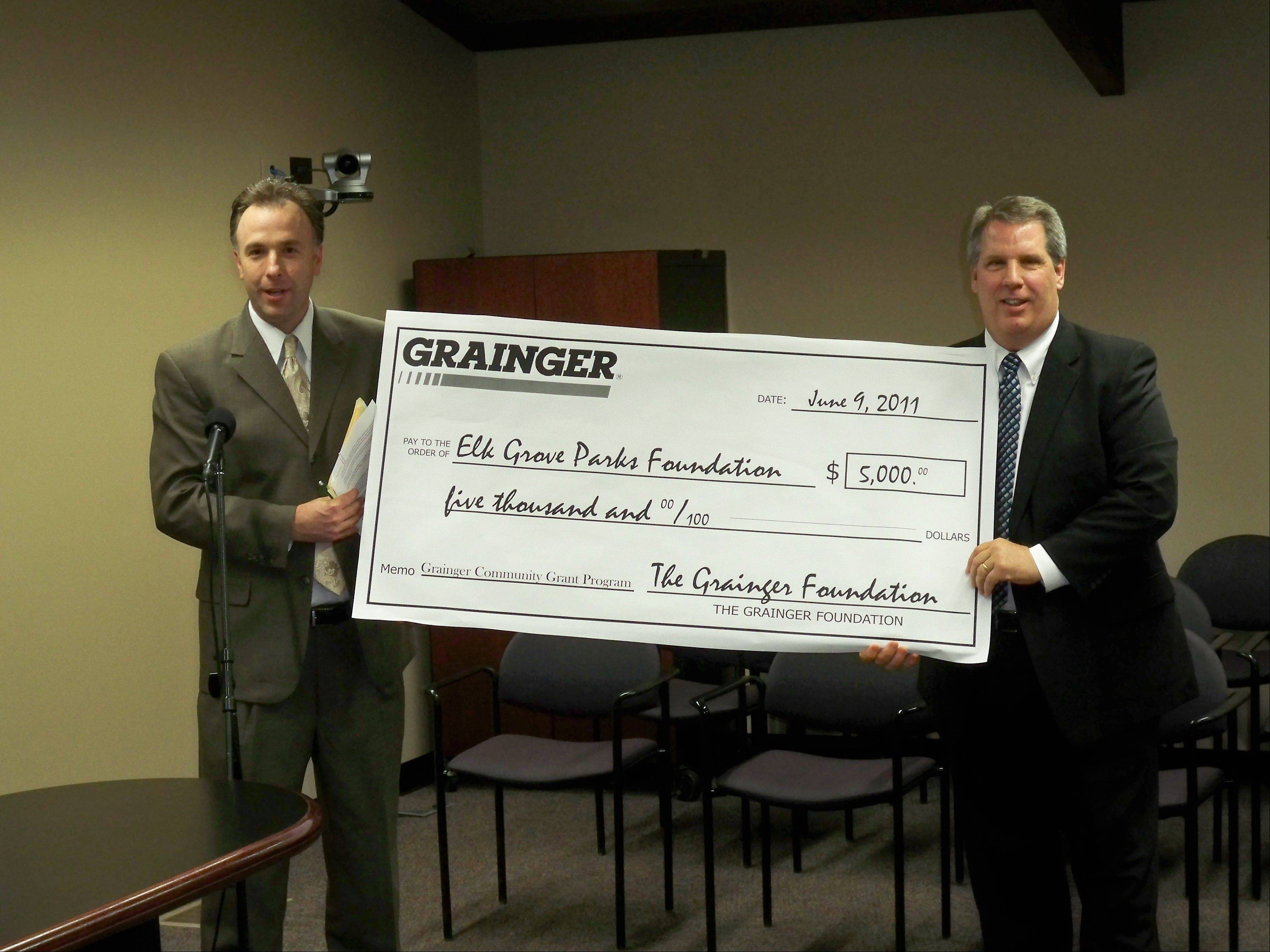 James Steffens, left, branch manager of Grainger in Bensenville, presents a $5,000 grant check to Tom Cooke, park board commissioner and president of the Elk Grove Parks Foundation.