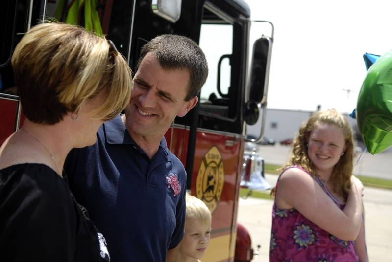 essay winner shows love for her firefighter dad phil kuhn smiles and gets a hug from his wife katie after they found out that