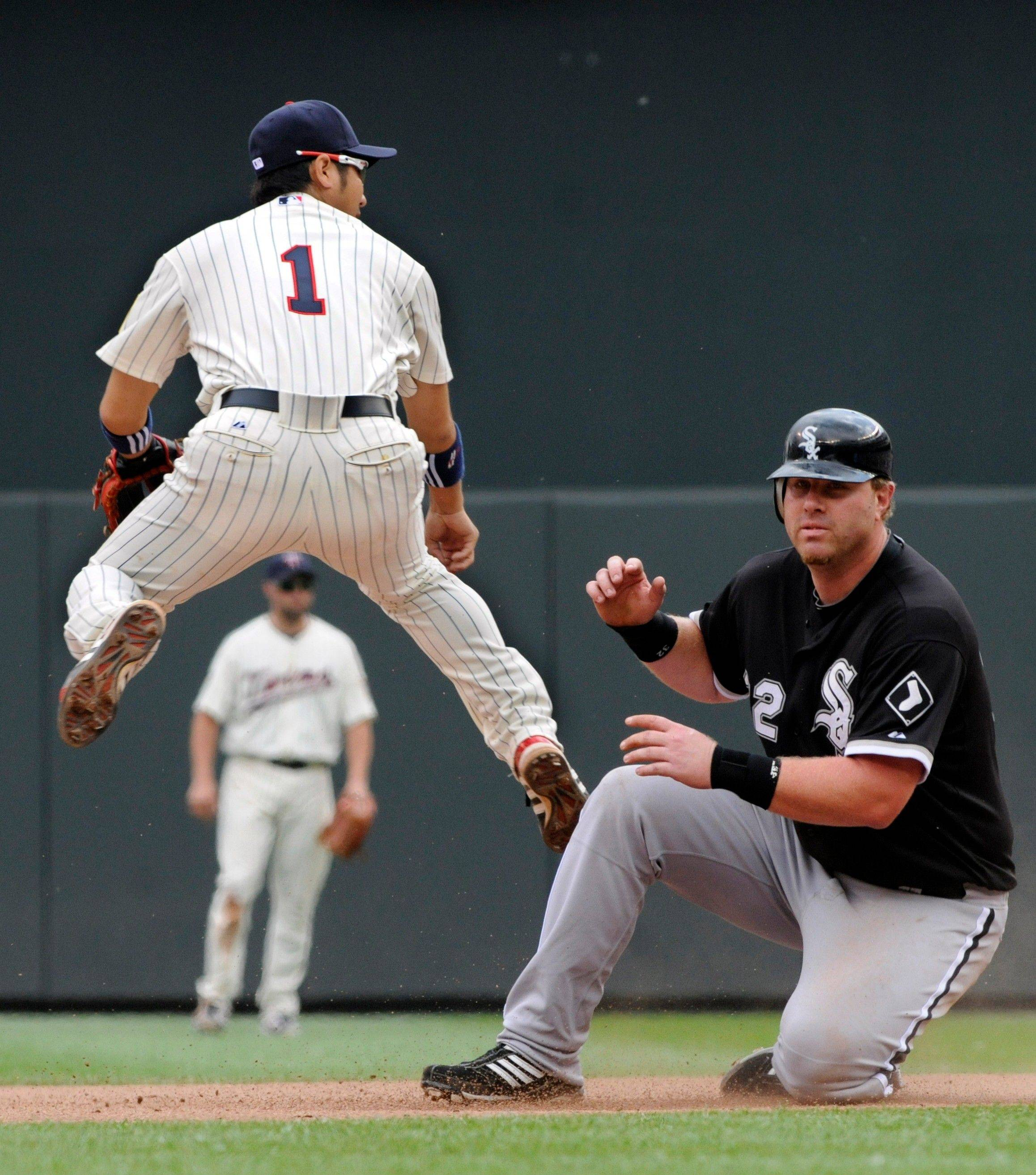 Twins shortstop Tsuyoshi Nishioka completes the double play after a force at second on Adam Dunn of the White Sox during the eighth inning Thursday. Gordon Beckham hit into the double play as the Twins won 1-0.