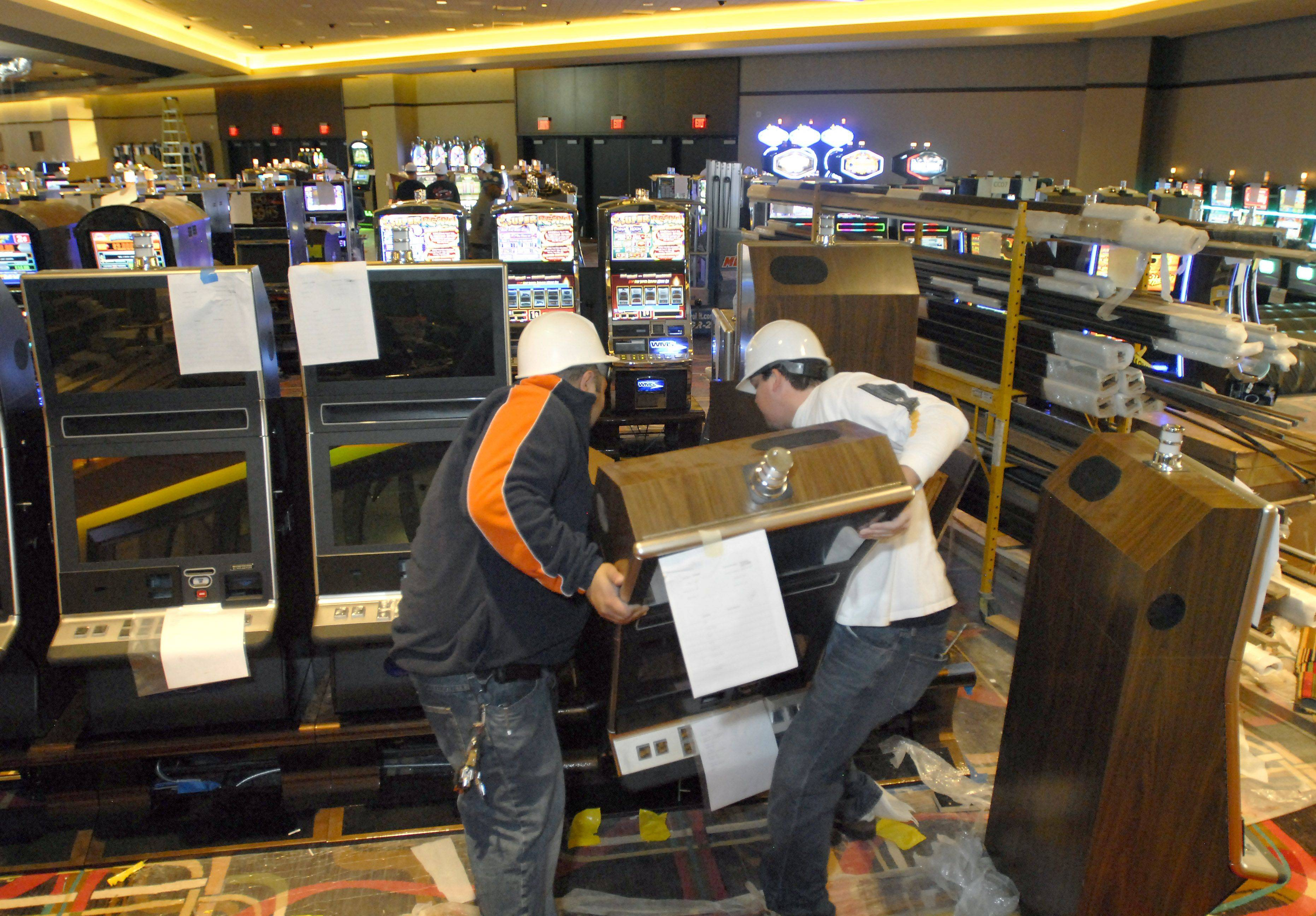 Workers are installing some of the 1,000-plus slot machines at the new Rivers Casino opening next month in Des Plaines. In addition to the slots, there will be 30 to 40 gaming tables.