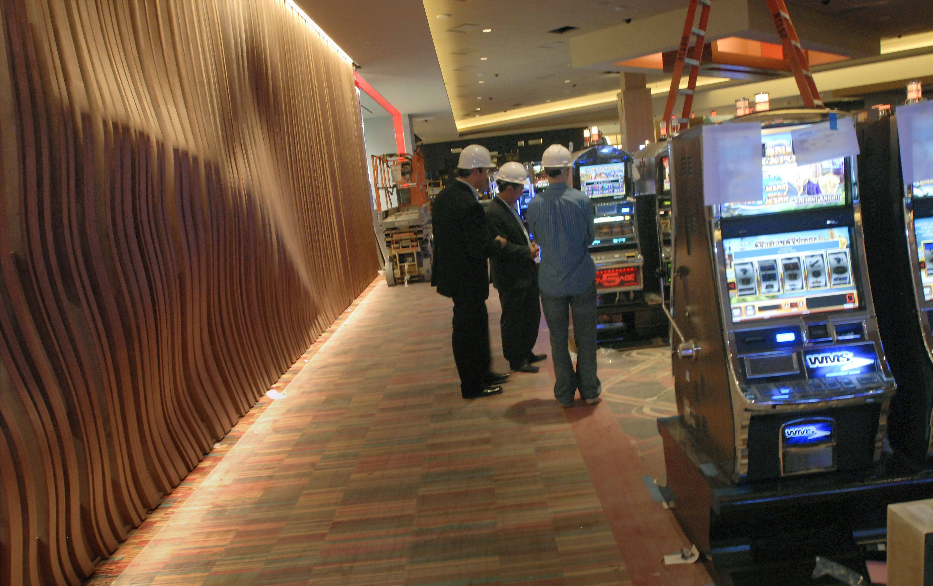 An undulating wall made of wood beams separates the gaming floor from the Canopy Buffet at the new Rivers Casino.