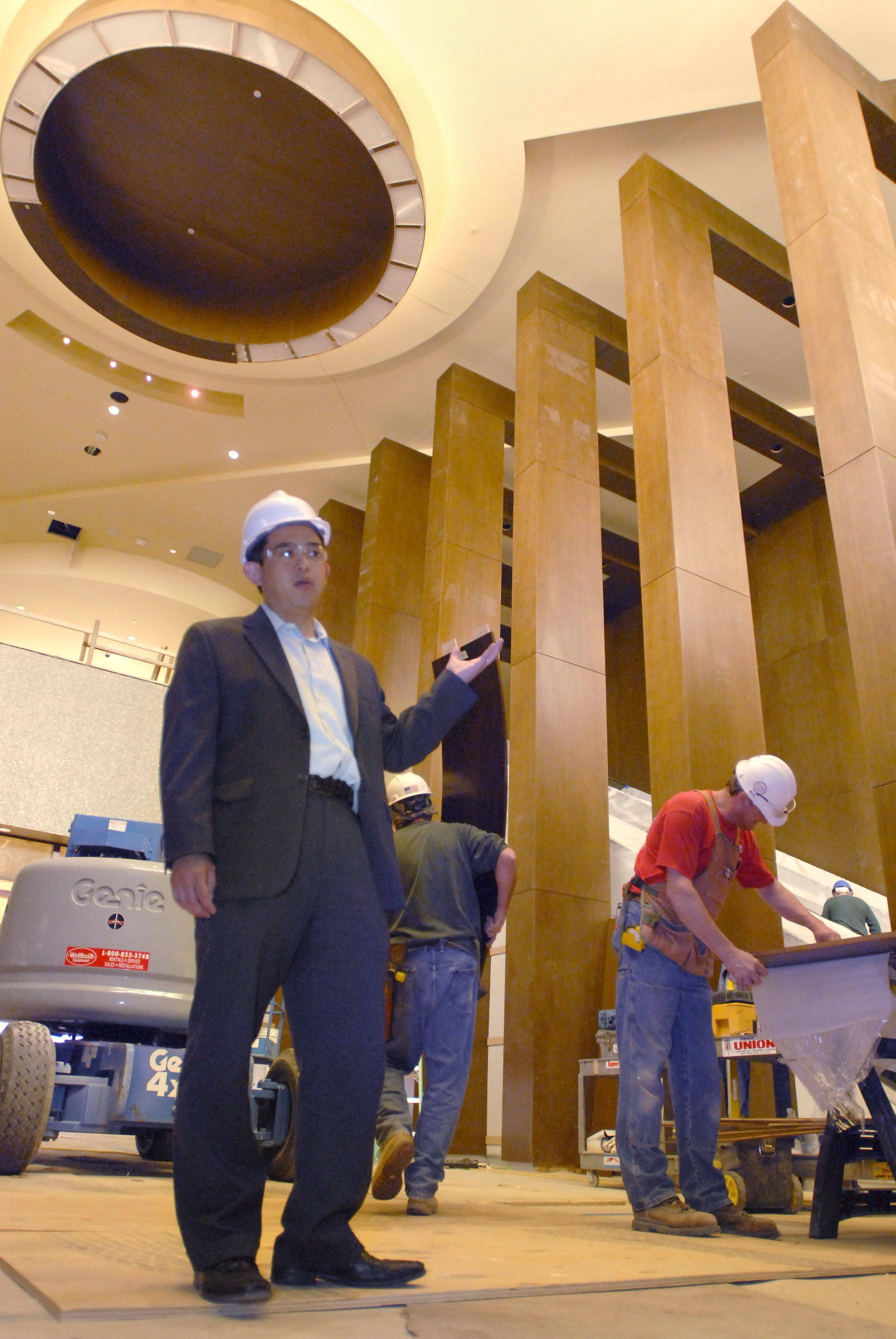 "Standing in the entrance, Albert Liu, vice-president of marketing for the new Rivers Casino in Des Plaines said, ""We have strived for a warm and open look, using lots of natural light, to make our guests feel comfortable here."""