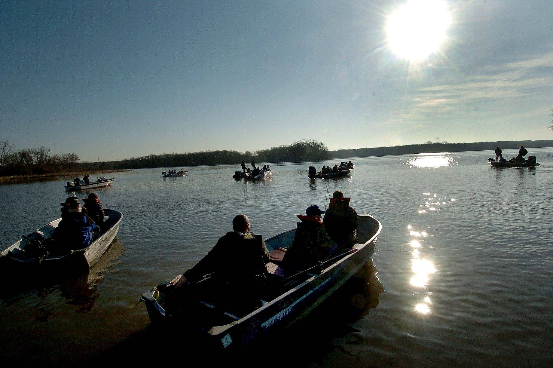 Boats head out onto Busse Lake for the sectionals of the IHSA bass fishing tournament in April.