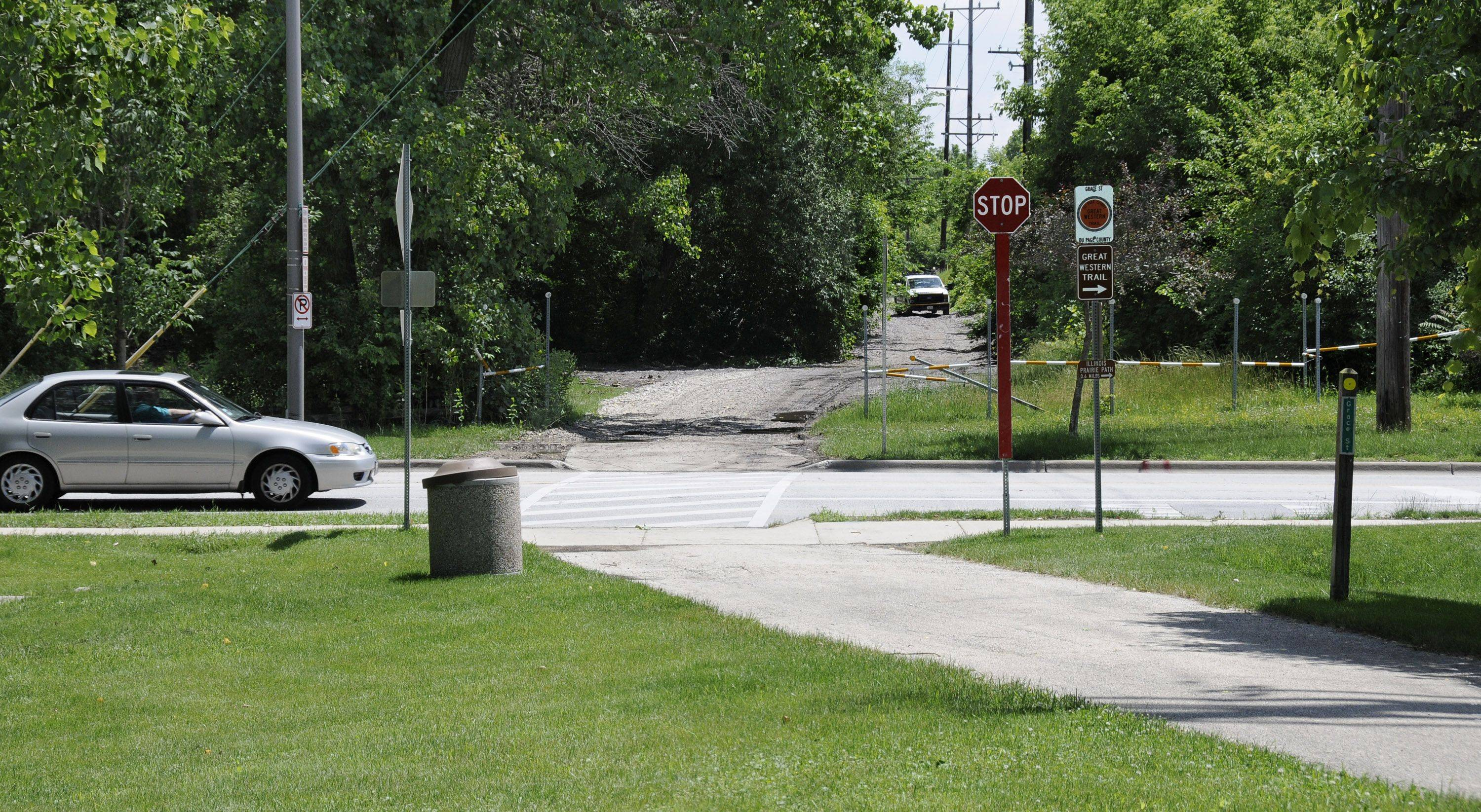 Great Western Trail users in Lombard now have to turn south on Grace Street, cross railroad tracks at St. Charles Road, then turn left to continue on the trail. Three pedestrian bridges being designed will allow the trail to continue straight east over both streets and the Union Pacific Railroad tracks.