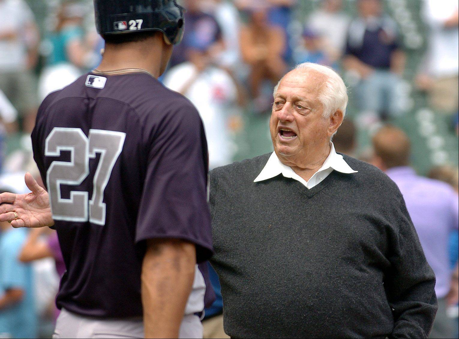 Former Dodgers manager Tommy Lasorda chats with Chris Dickerson of the Yankees during batting practice before the Cubs vs. Yankees at Wrigley Field.