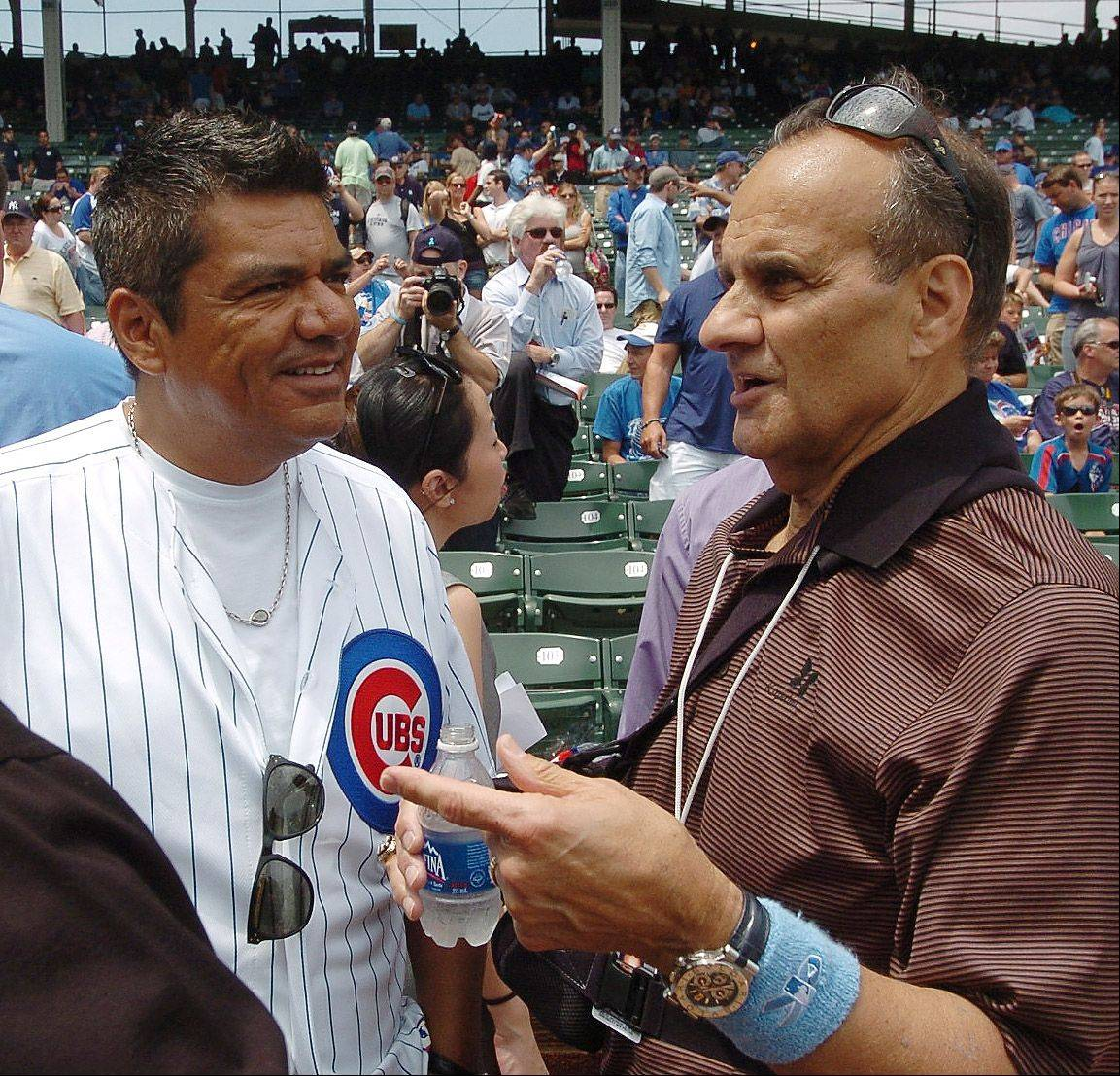 Joe Torre chats with comedian George Lopez, who threw out the first pitch at Cubs vs. Yankees at Wrigley Field.