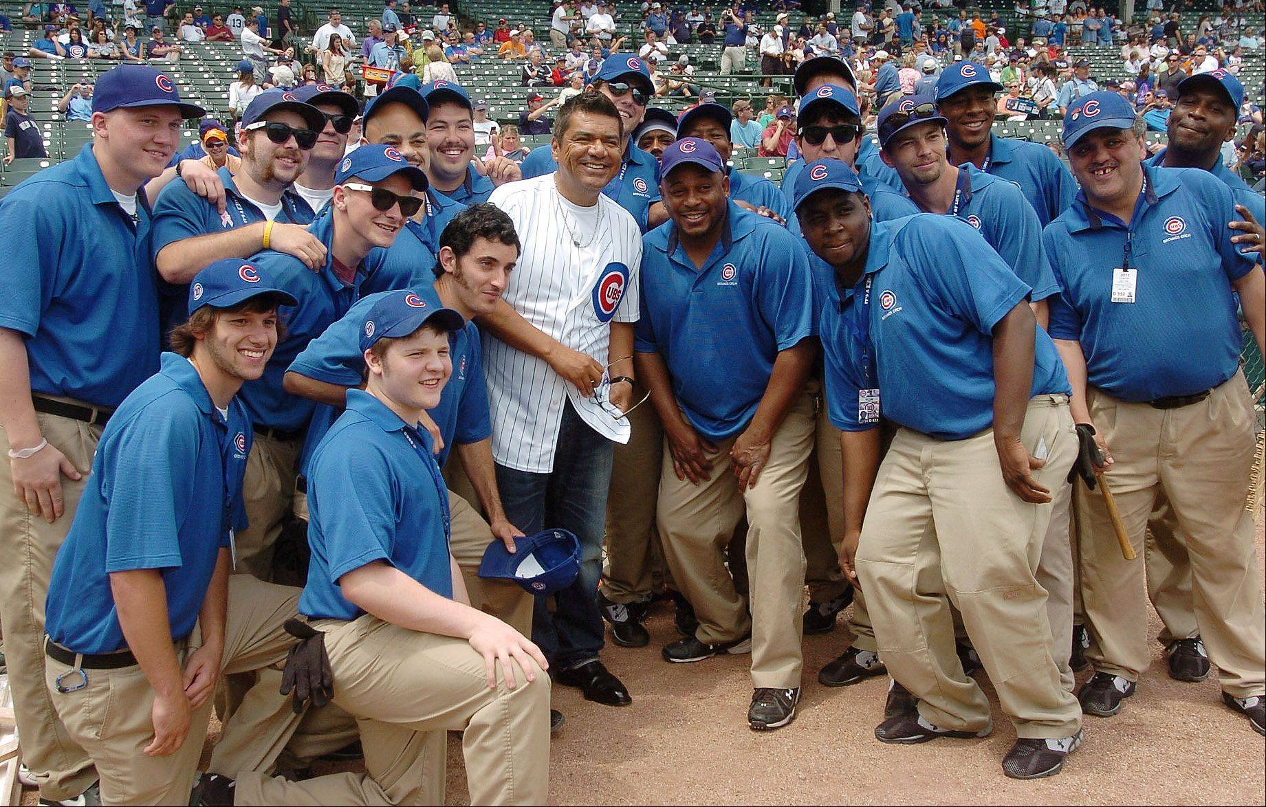 Bob Chwedyk/bchwedyk@dailyherald.comGeorge Lopez gets his picture taken with the grounds crew before Cubs vs. Yankees at Wrigley Field. Lopez also threw out the first pitch.