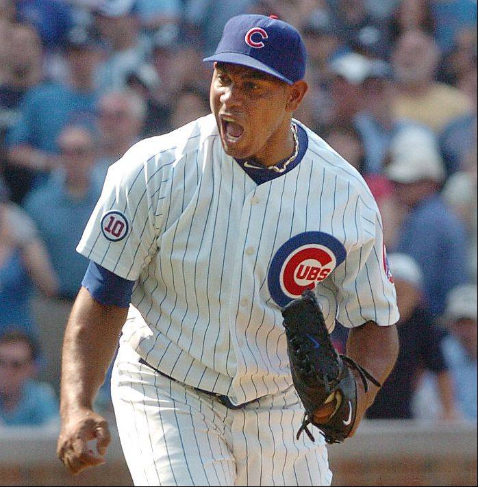 Cubs closer Carlos Marmol reacts to his game-ending strikeout and save against the Yankees.