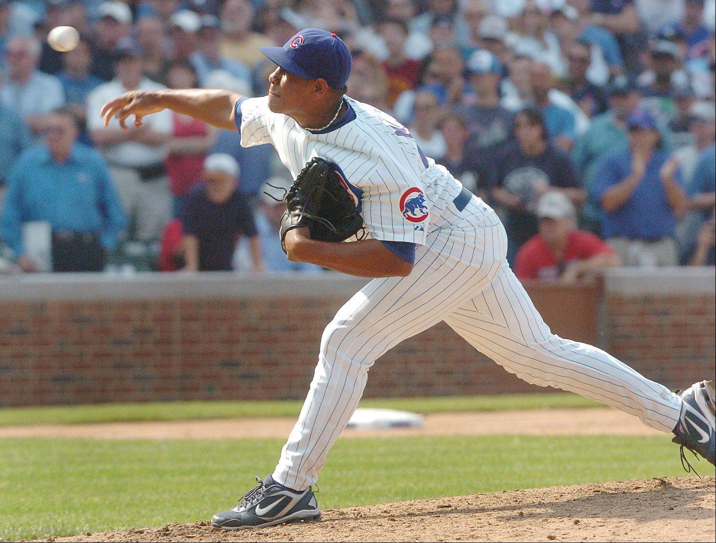 Cubs closer Carlos Marmol fires the final pitch against the Yankees.
