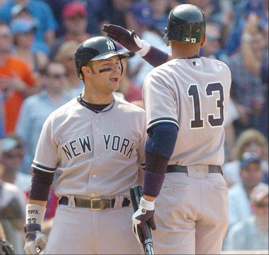The Yankees' Nick Swisher gets a friendly tap on the head from Alex Rodriguez after scoring New York's only run.