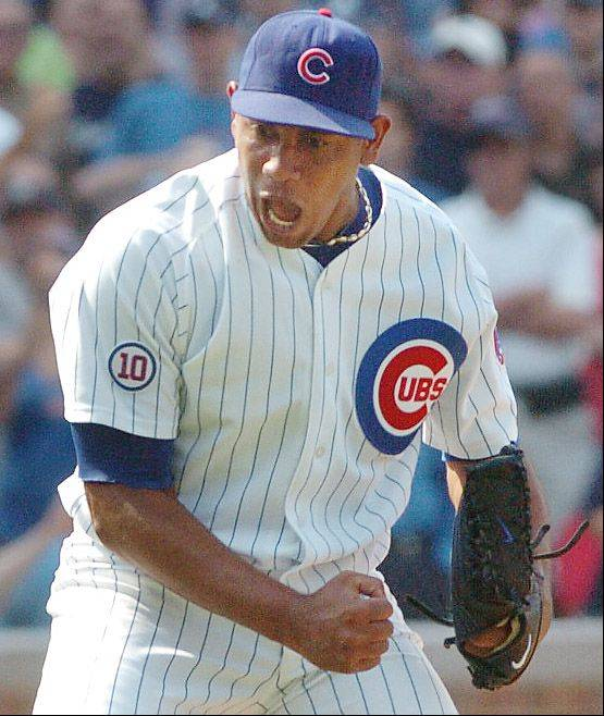 Cubs closer Carlos Marmol pumps his fist after getting the final strikeout to beat the Yankees at Wrigley Field.