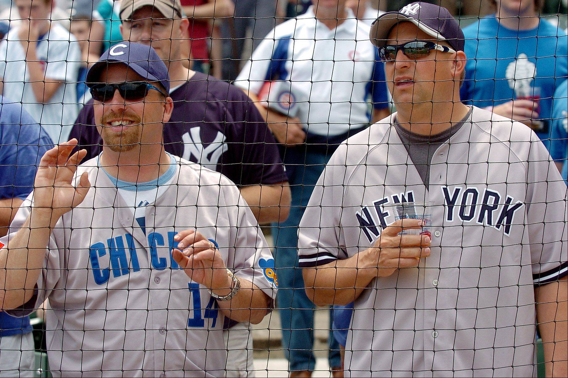 John Gidley, left, and Andy Sislo, both from Superior, Wisconsin, enjoy batting practice before the game. The tickets to the game was an early Father's Day gift from their wives.