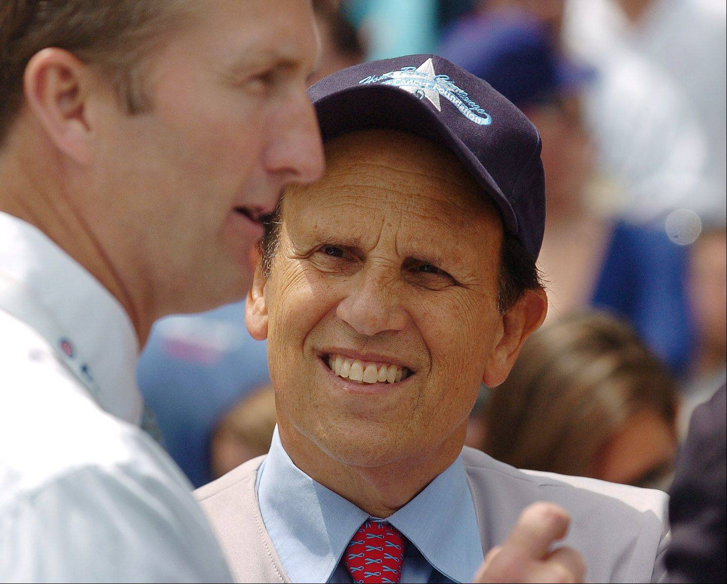 Michael Milken, right, talks with Crane Kenney of the Cubs before the game.