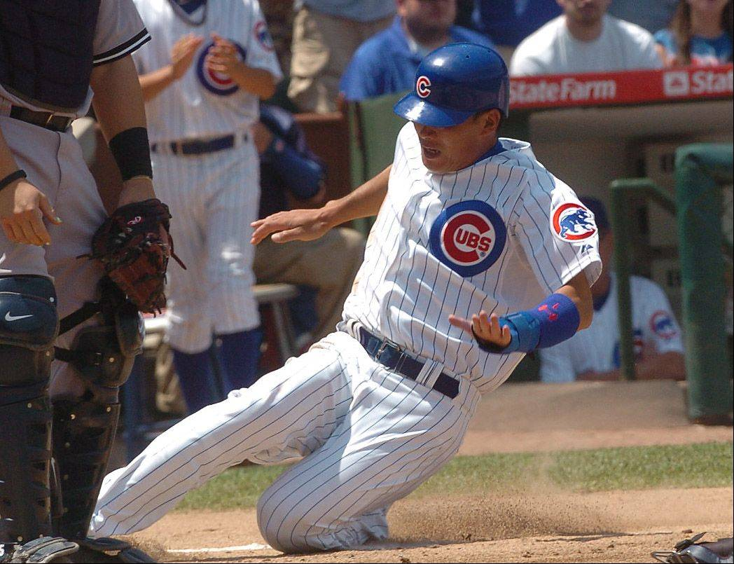 Kosuke Fukudome slides home for the first run of the game during Cubs vs. Yankees at Wrigley Field.