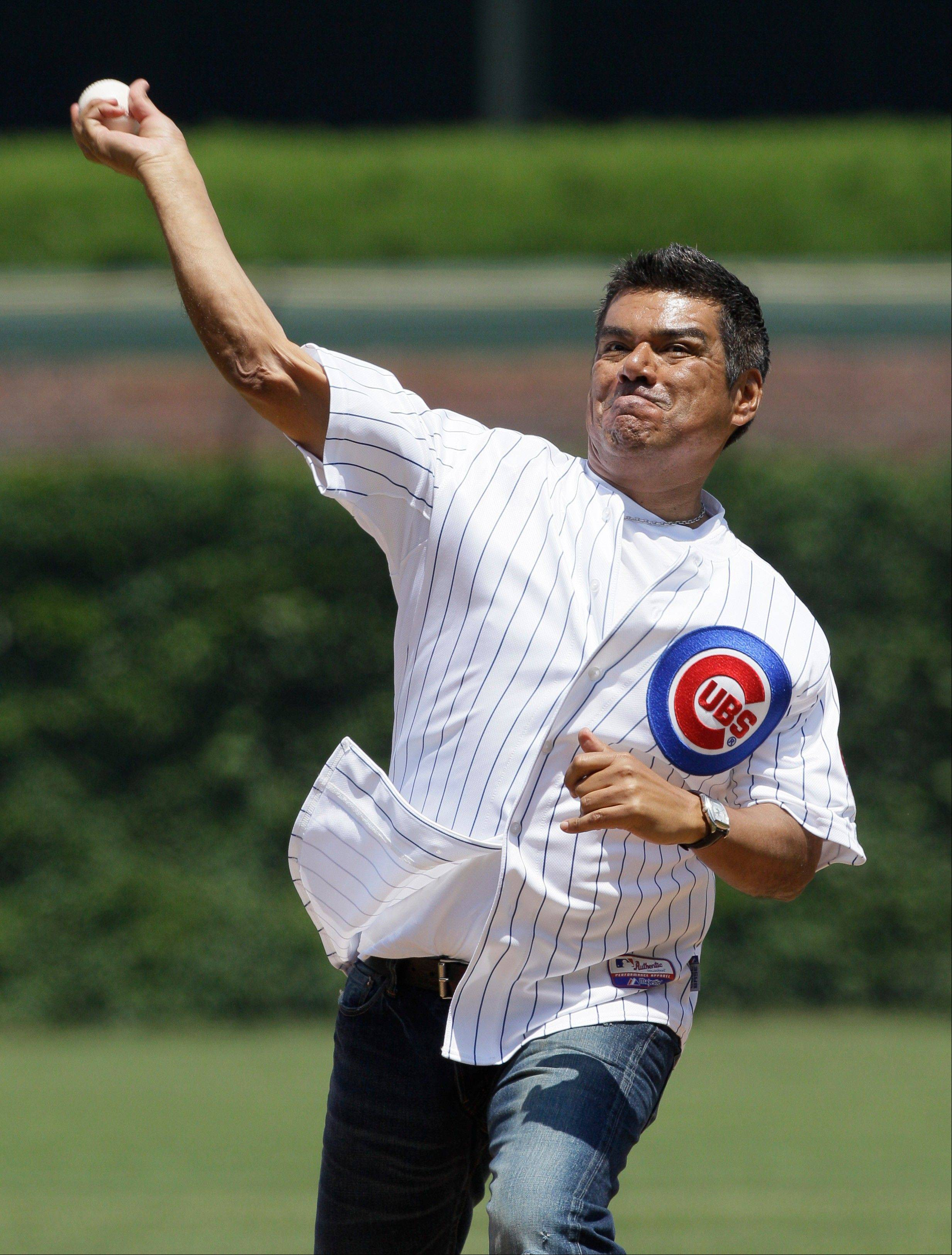 Actor George Lopez throws out the ceremonial first pitch before an interleague baseball game between the New York Yankees and the Chicago Cubs in Chicago, Friday, June 17, 2011.