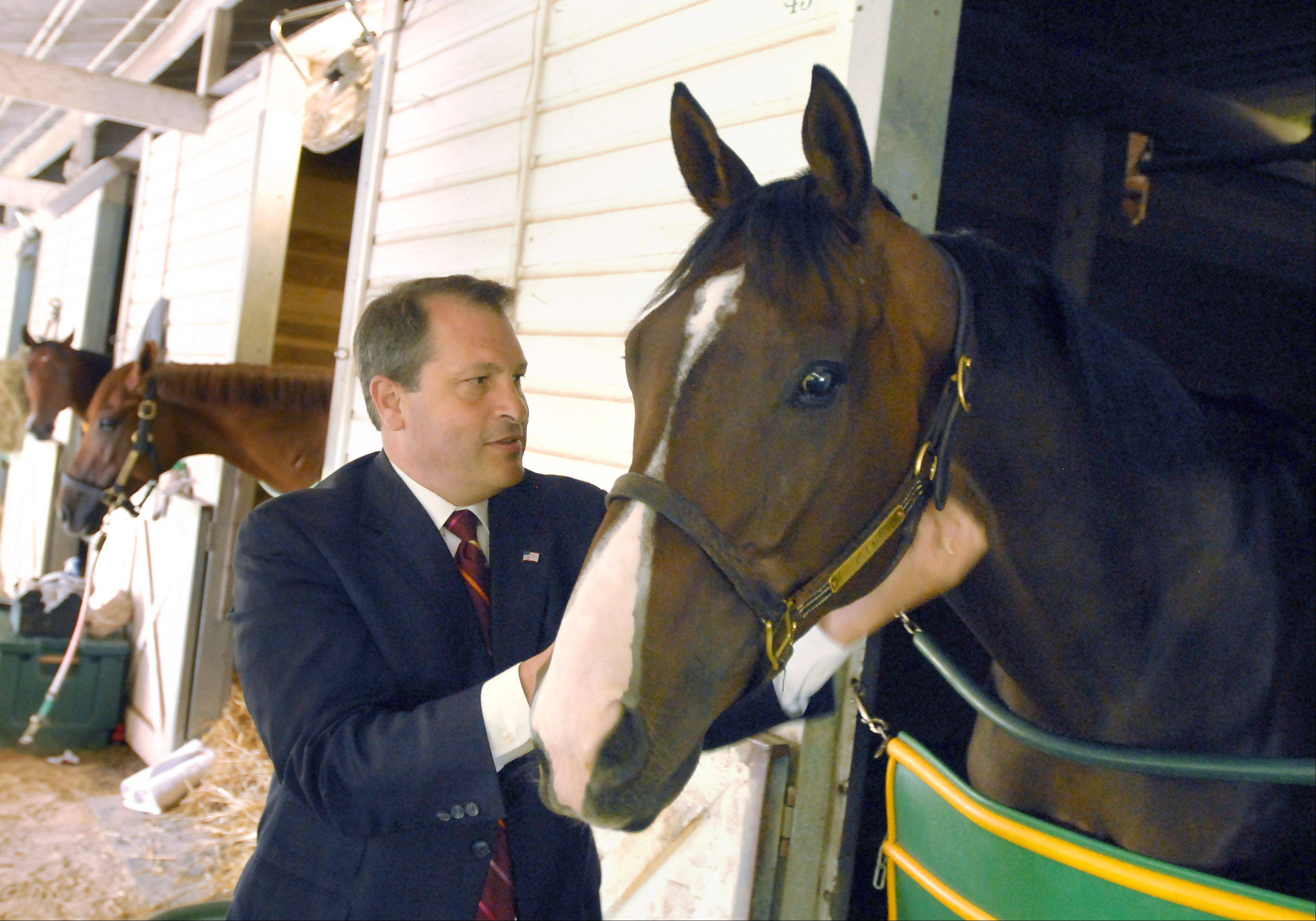 Arlington Park general manager Anthony Petrillo gets acquainted with Repenter owned by Apman Racing in Barrington.
